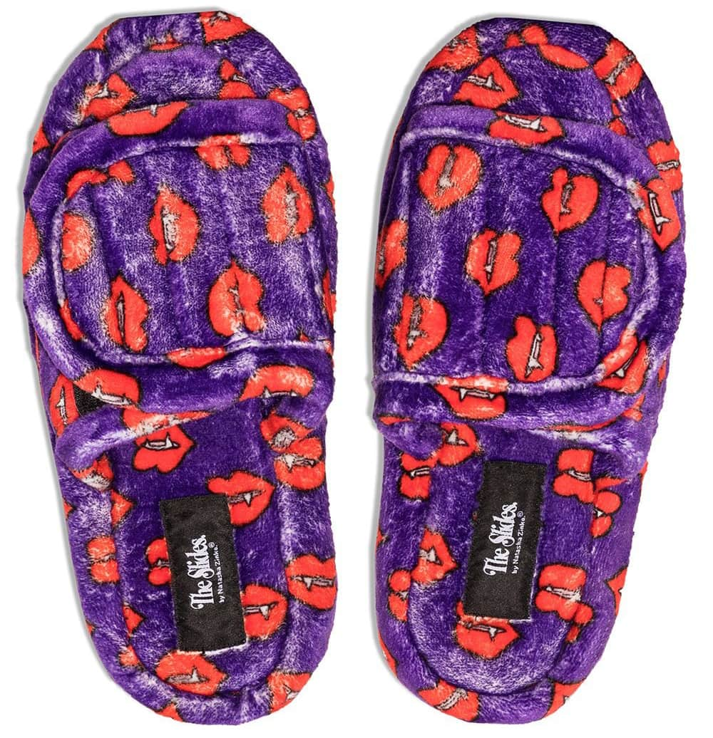 Make a statement in these furry fang-print purple slides with touch-strap fastenings