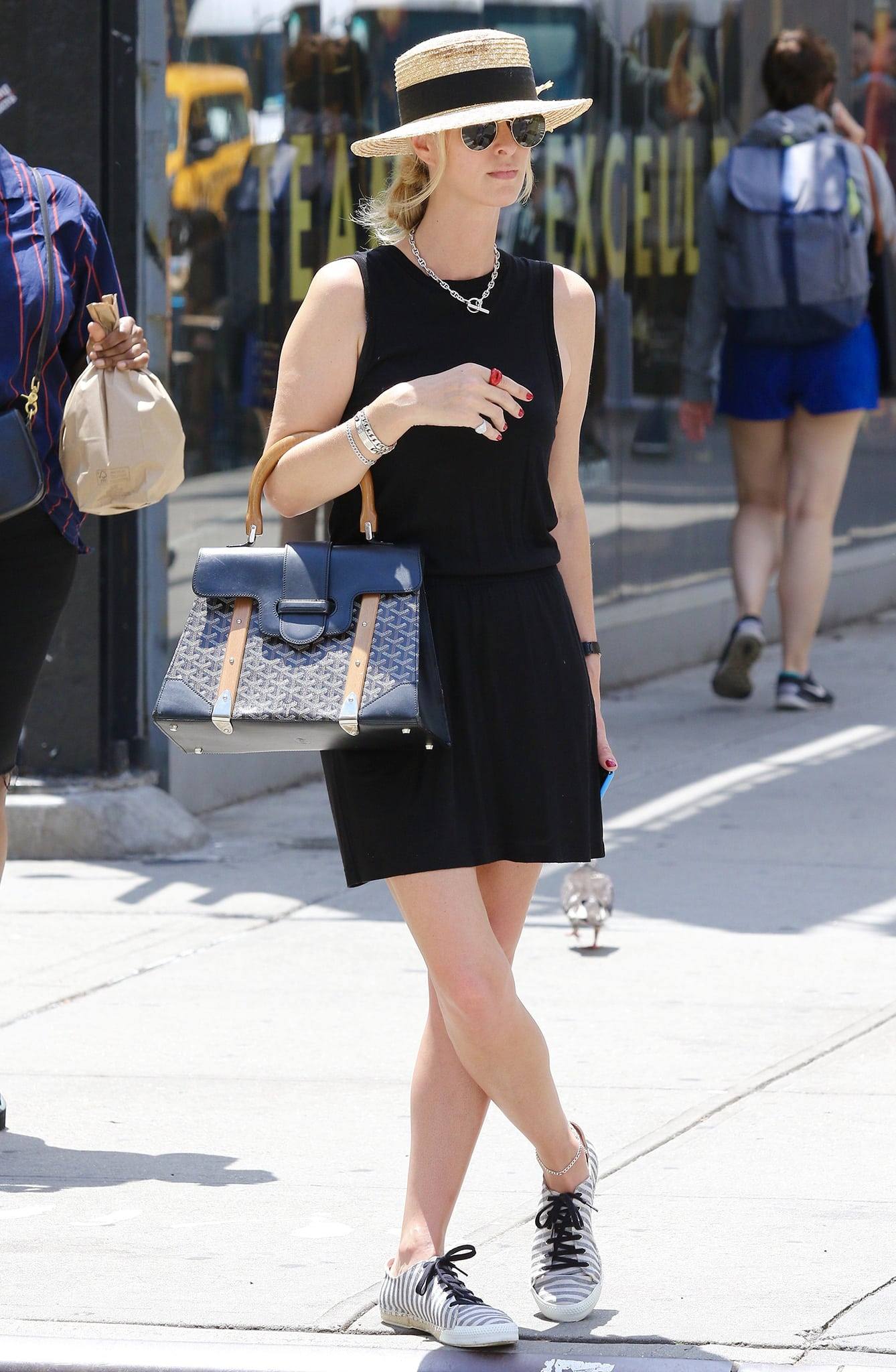 Nicky Hilton wears her French Sole Amanda shoes with a black sleeveless mini dress on June 9, 2021
