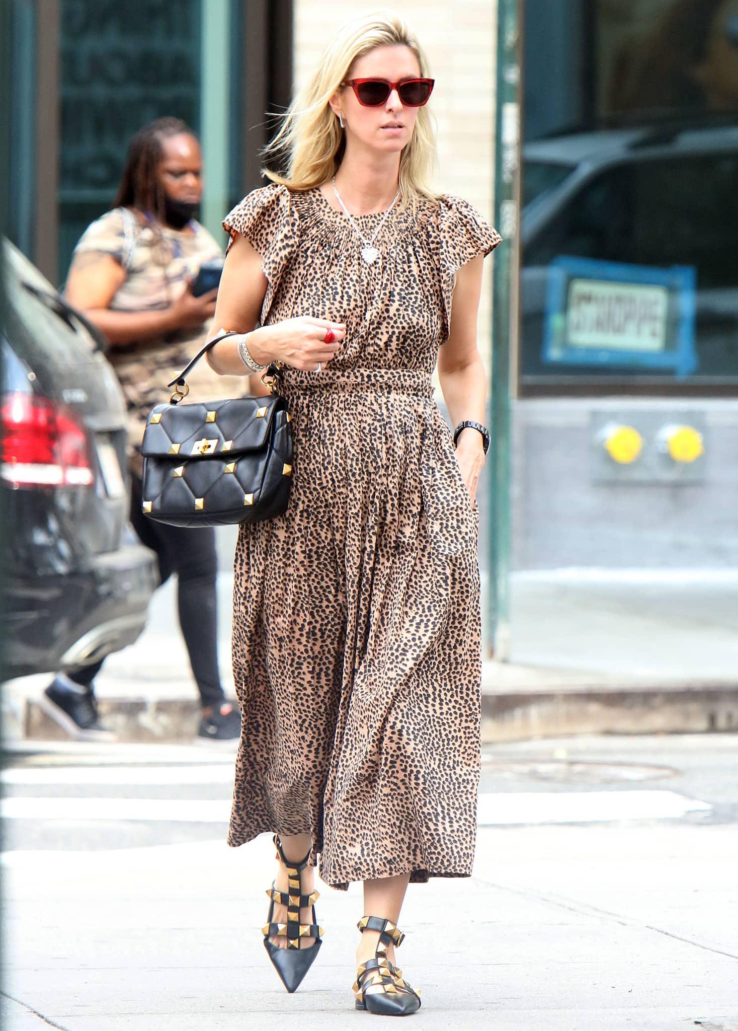 Nicky Hilton runs errands in Ulla Johnson leopard-print midi dress on June 7, 2021