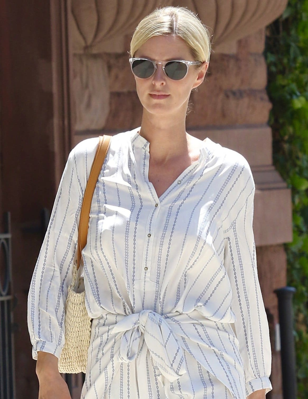 Nicky Hilton wears an off-center low bun with barely-there makeup