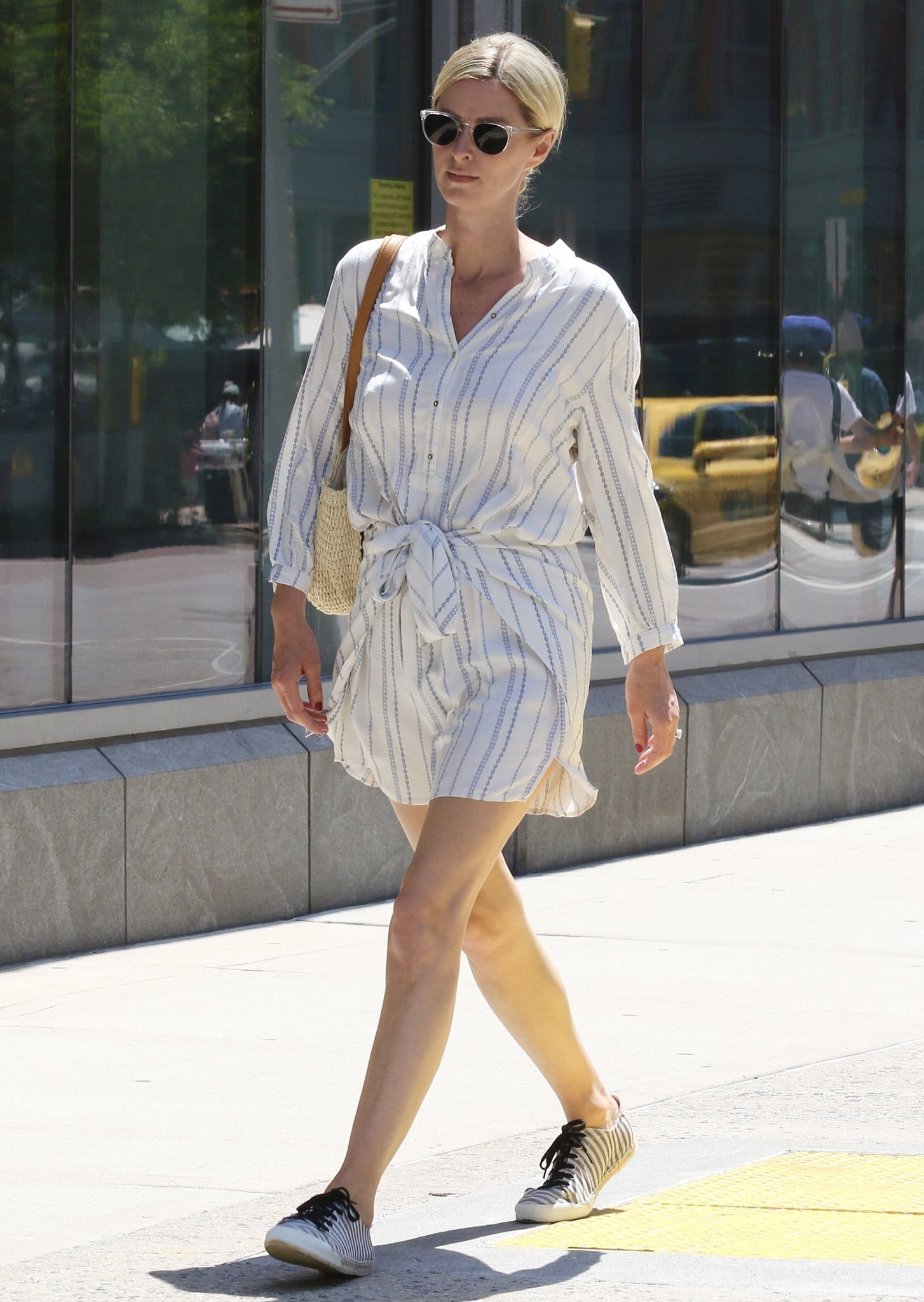 Nicky Hilton runs errands in a summery white striped romper in New York City on June 10, 2021