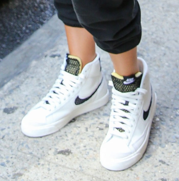 Olivia Culpo completes her sporty gym look with Nike Blazer Mid sneakers with black and neon green mesh tongues
