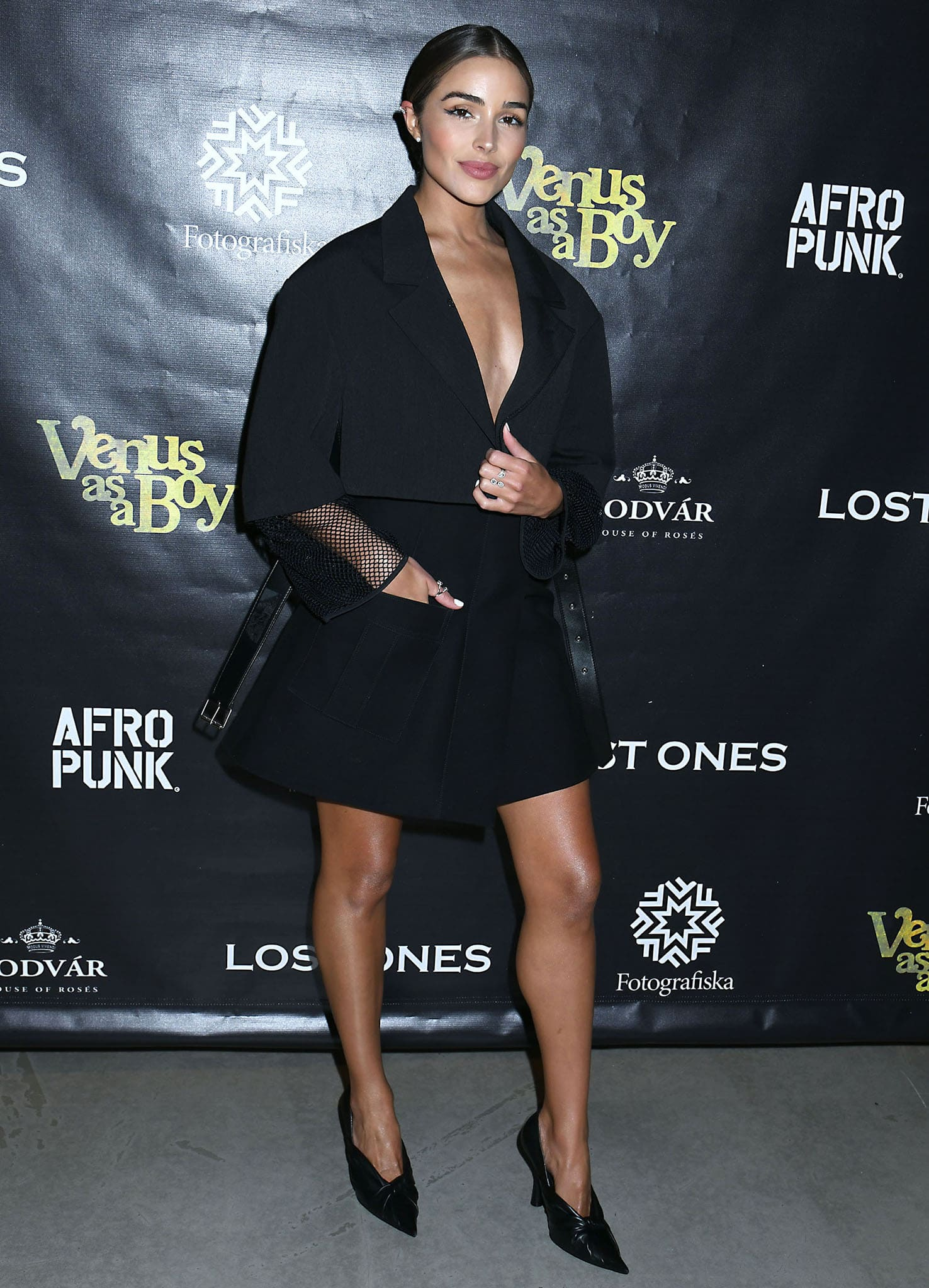 Olivia Culpo wears nothing underneath her Louis Vuitton cropped tailored jacket