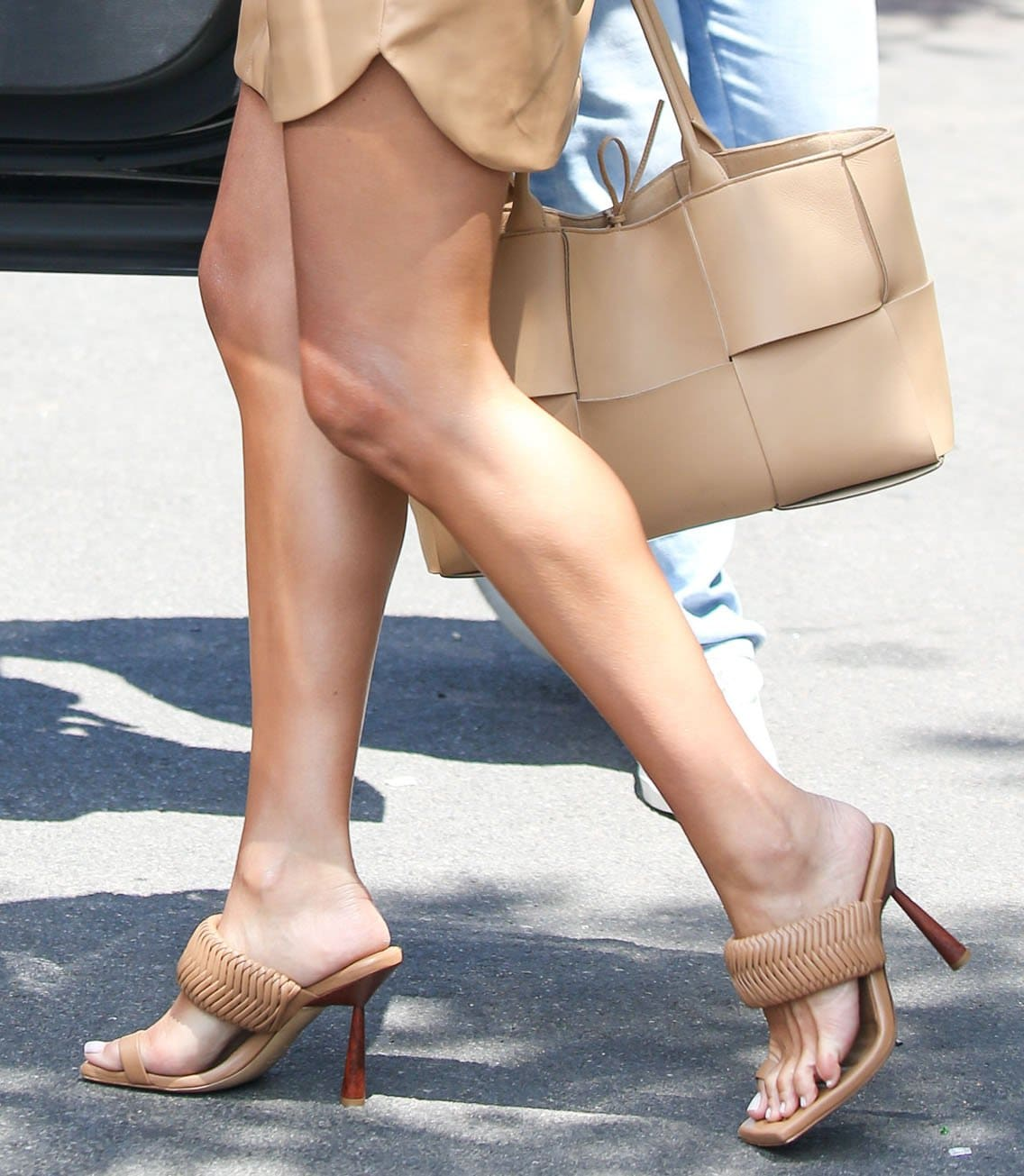Olivia Culpo completes her head-to-toe beige look with a Bottega Veneta Arco tote and Gia Couture x Rosie Huntington-Whiteley sandals