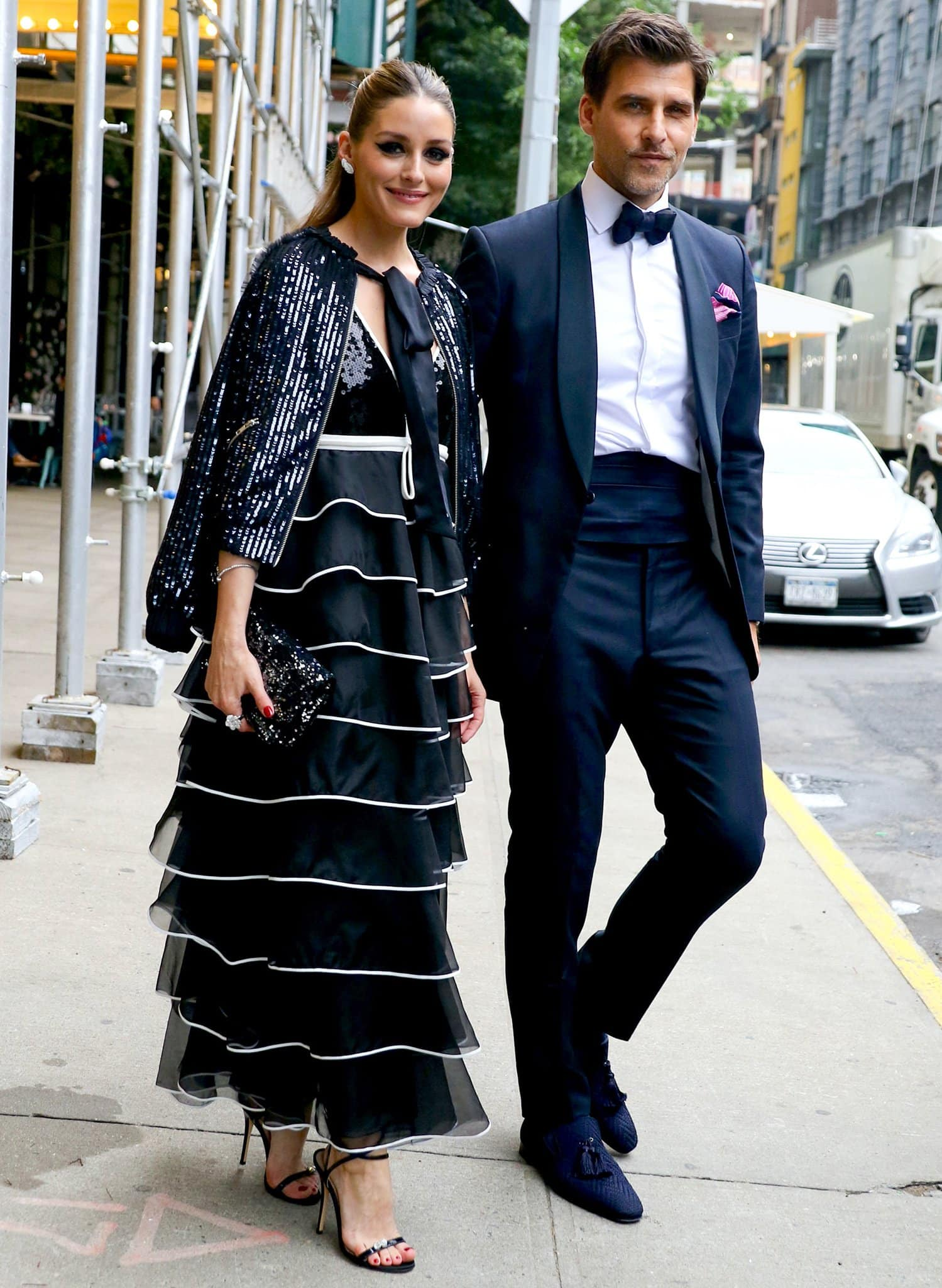Olivia Palermo stuns in a Giambattista Valli tiered ruffled dress and a sequined jacket while Johannes Huebl looks handsome in a black suit with a bowtie