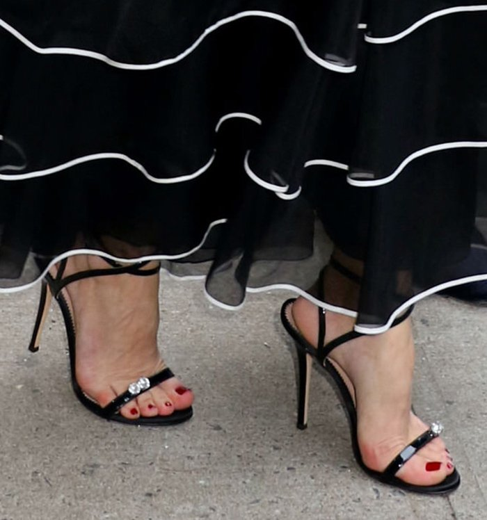 Olivia Palermo completes her evening look with Giuseppe Zanotti Ellie sandals that are dotted with two crystals studs