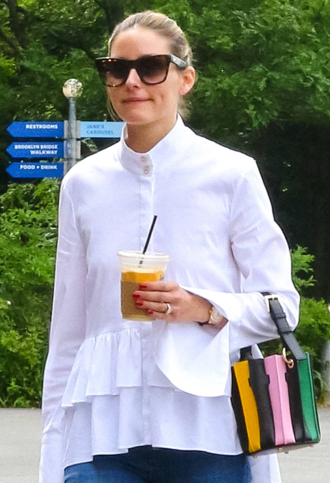 Olivia Palermo pulls her tresses back into a neat bun and carries a colorful striped mini bucket bag from Sara Battaglia