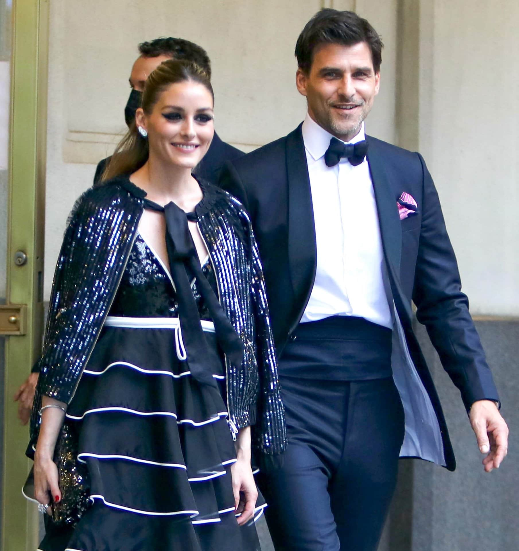 Olivia Palermo accessorizes with Piaget diamond earrings, a bracelet, a statement ring, and a Zara clutch