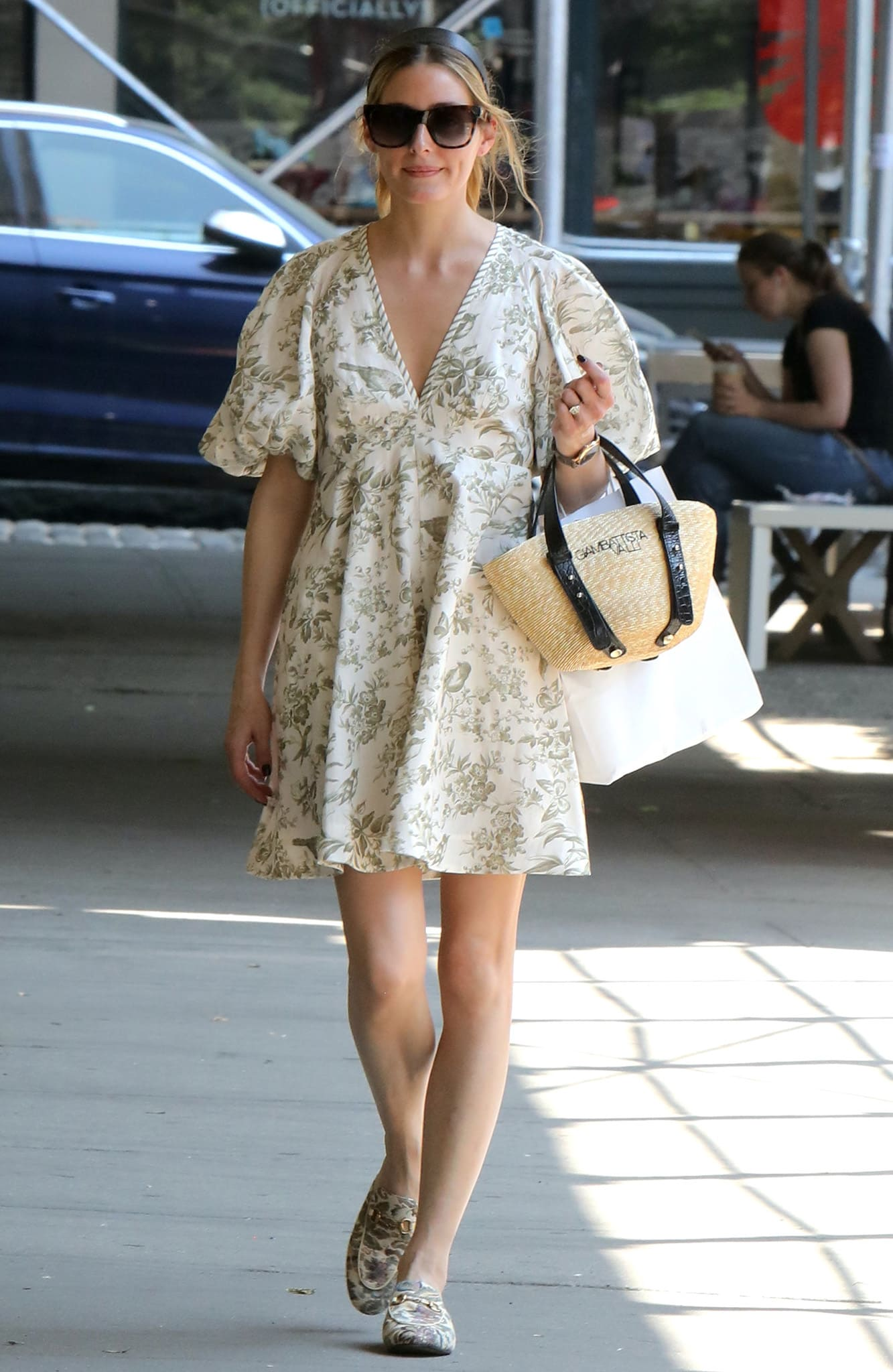 Olivia Palermo shows off her legs in Zimmermann flora-inspired mini dress