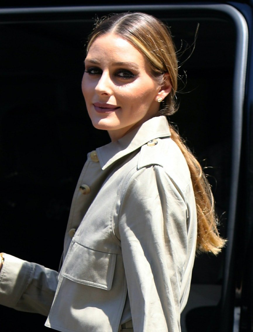 Olivia Palermo glams up with mascara and eyeshadow and keeps her long tresses away from her face