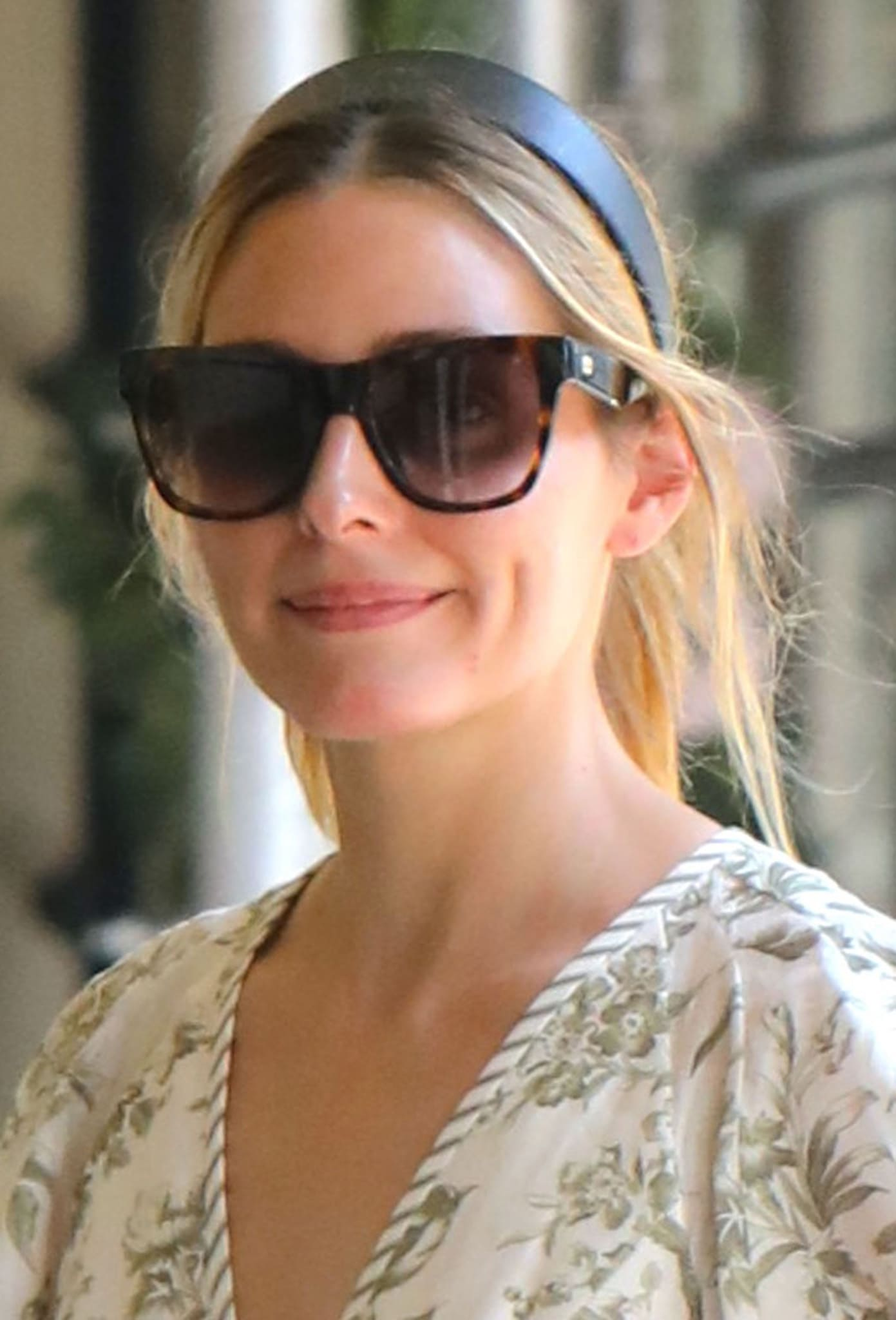 Olivia Palermo keeps her look girly with a ponytail and a thick headband