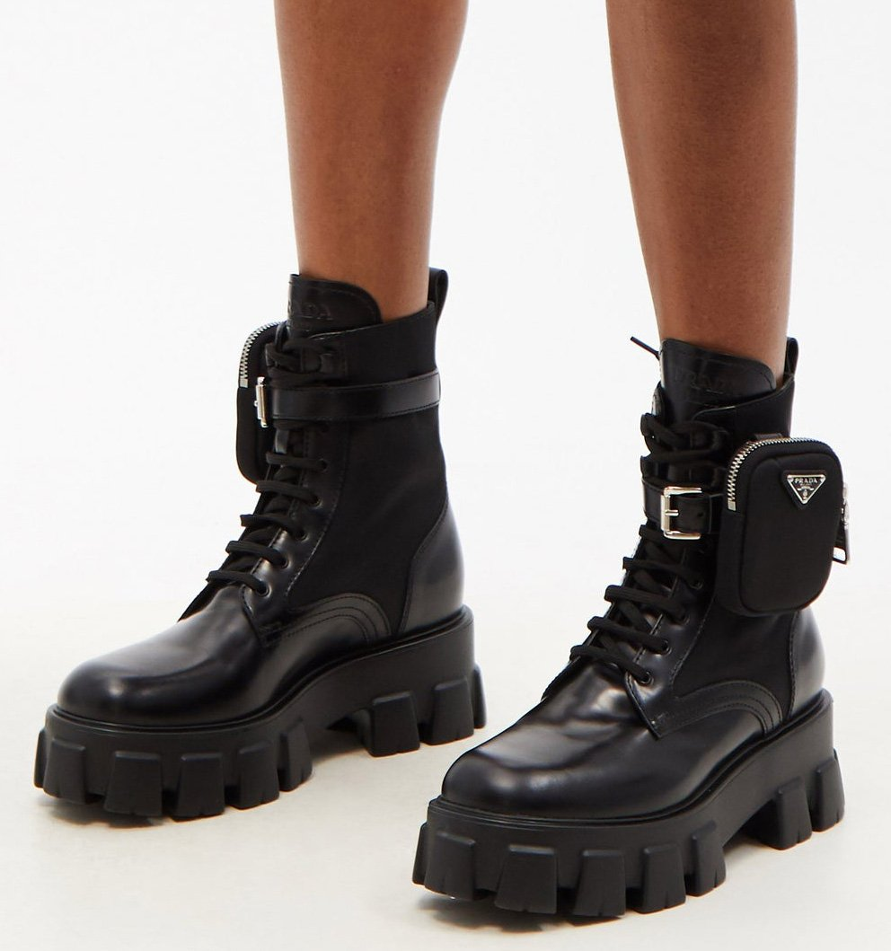 A pair of military-inspired boots with a detachable pouch and chunky lug soles