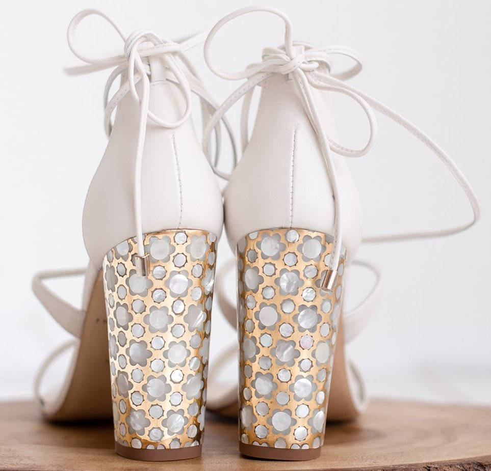 Freya Rose's Soraya statement sandal features a unique mother of pearl and polished brass block heel with a carefully crafted floral design