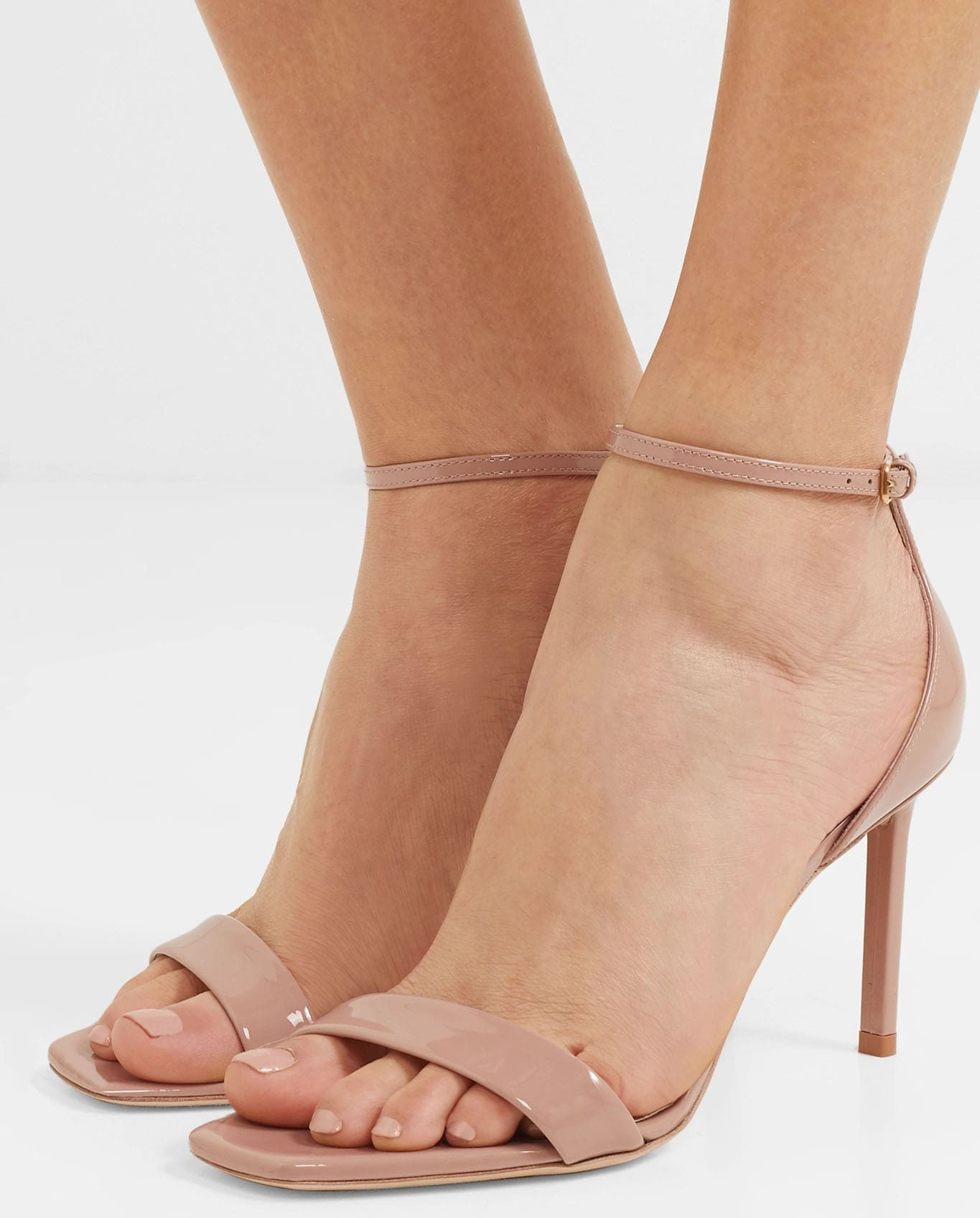 The Amber sandal features a delicate ankle strap and a square toe to keep your toes inside the shoe