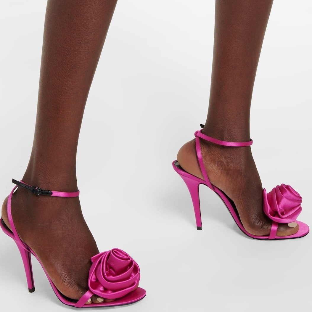 Fuchsia pink Ivy sandals from Saint Laurent featuring gathered floral appliqués at the toe straps