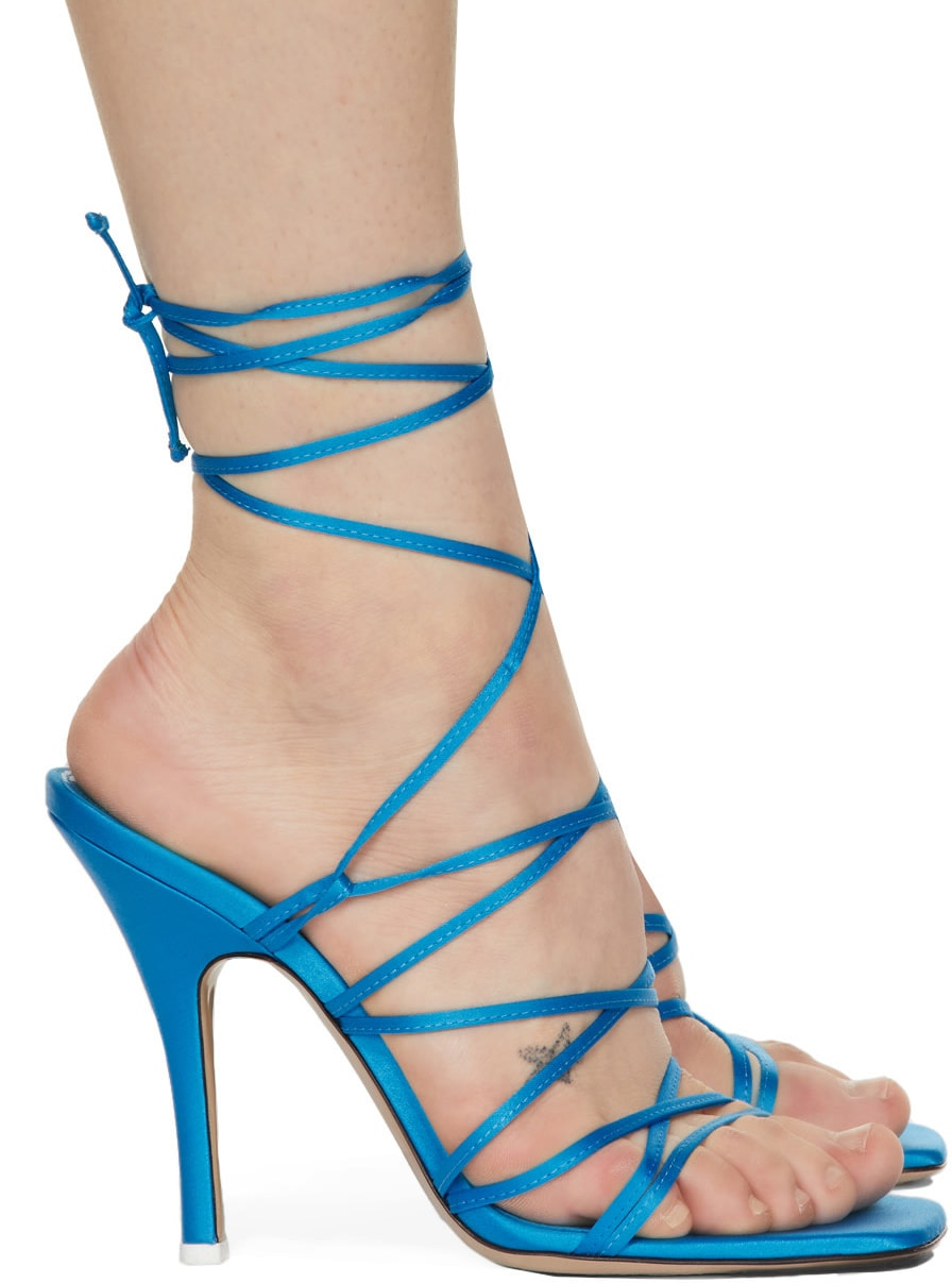 The Attico's Fiona sandals have slender straps that weave around the legs and feet