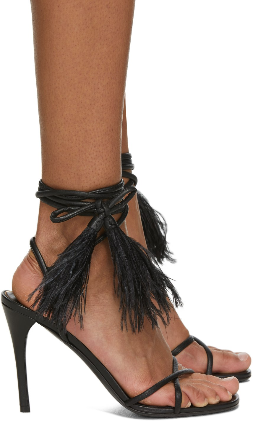 Crafted from leather, these black Upflair sandals from Valentino Garavani are decorated with tassel detailing