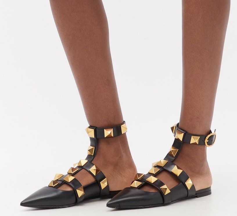 These Valentino Garavani flats are decorated with large Rockstuds and have ankle straps and a backless silhouette