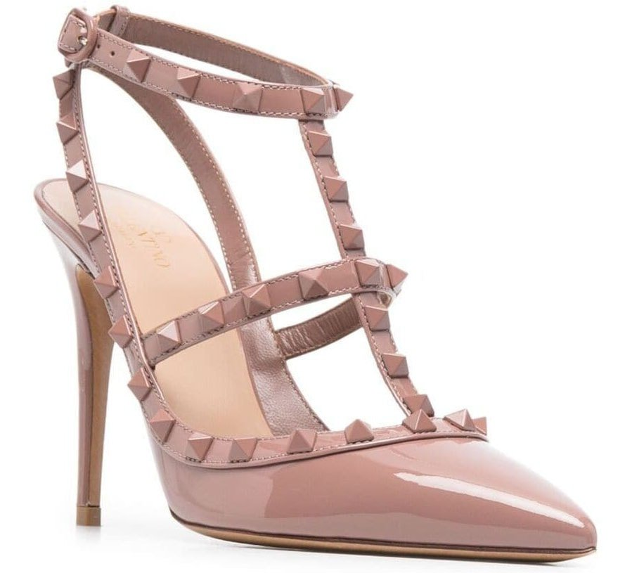 One of Valentino's most popular styles is the Rockstud Slingback Ankle-Strap Pumps with closed pointed toes