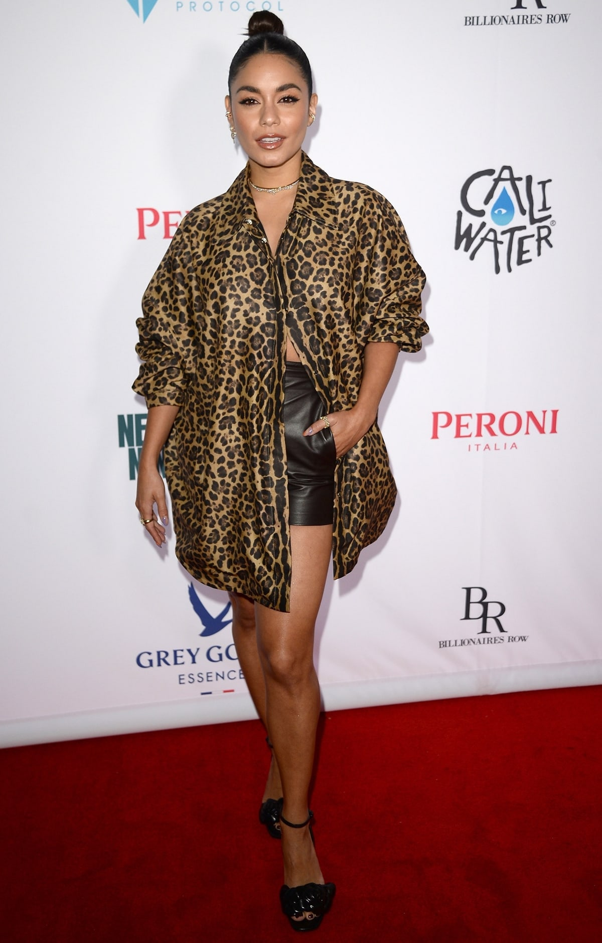 Vanessa Hudgens styled her leopard-print oversized shirt with black leather shorts