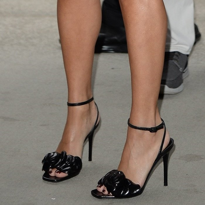 Vanessa Hudgens shows off her feet in black Atelier 03 rose edition sandals from Valentino Garavani