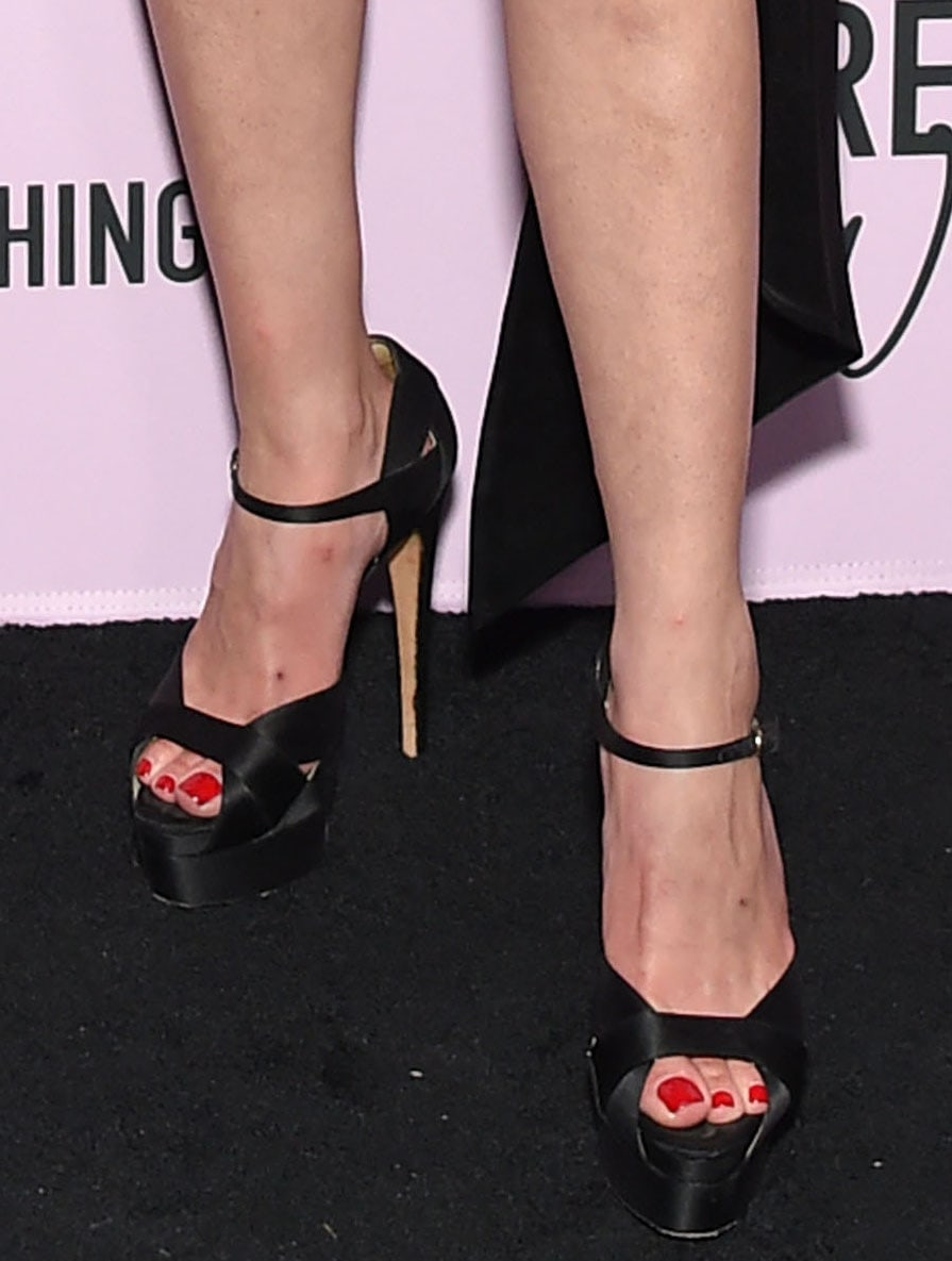 Ashley Benson shows her red pedicure in Brian Atwood Aida sandals