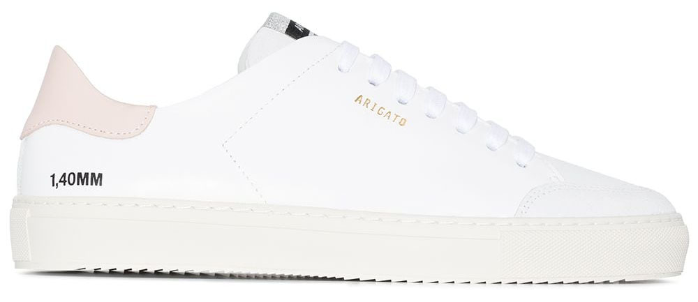 A minimalist pair of white leather sneakers updated with contrasting toe and heel counter