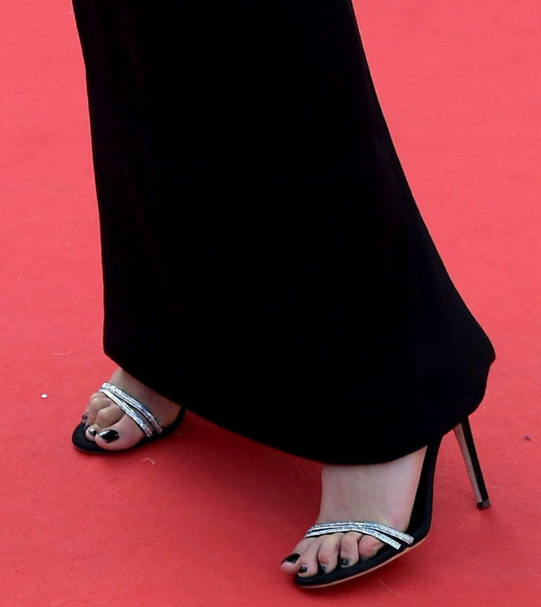 Bella Hadid shows off her black pedicure in a pair of Giuseppe Zanotti Anise crystal-embellished sandals