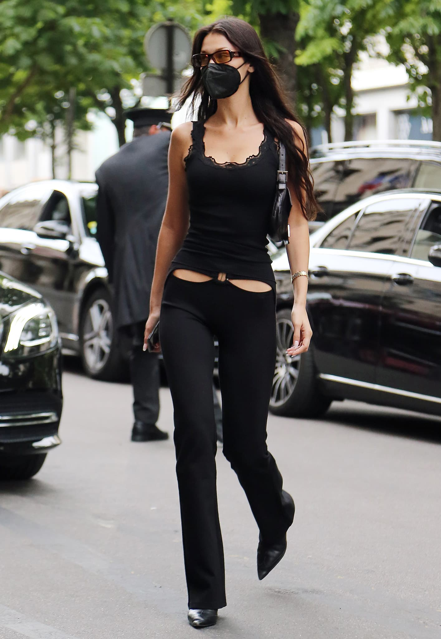 Bella Hadid wears a sleek and sexy black look for Jacques Muss fitting in Paris on June 28, 2021
