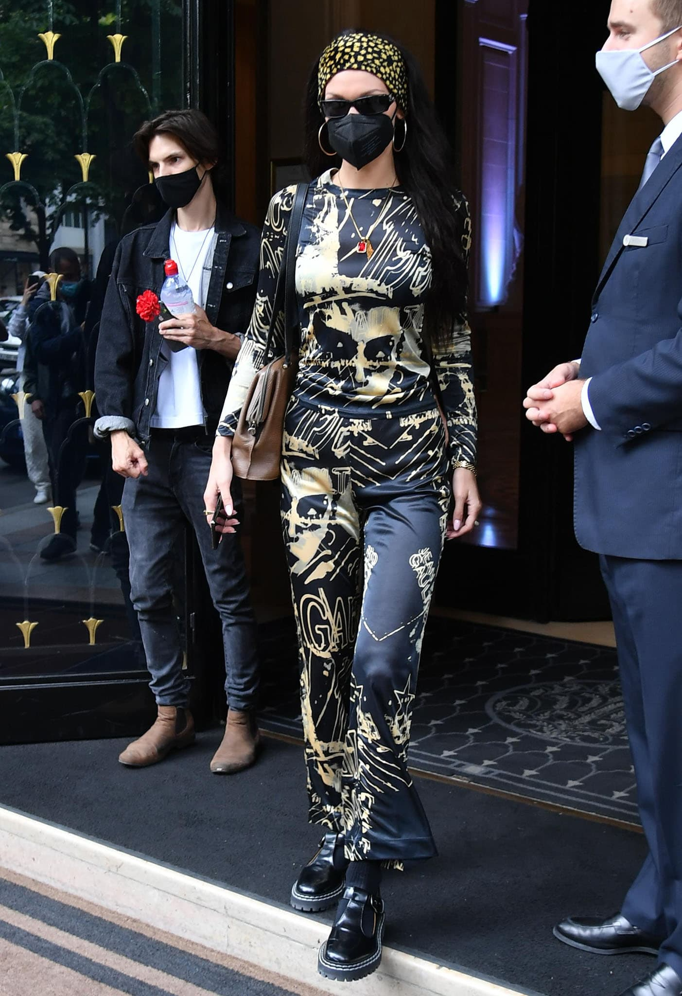 Bella Hadid leaving Royal Monceau Hotel in Jean-Paul Gaultier long-sleeved top and matching pants with Proenza Schouler Mary Janes on July 7, 2021