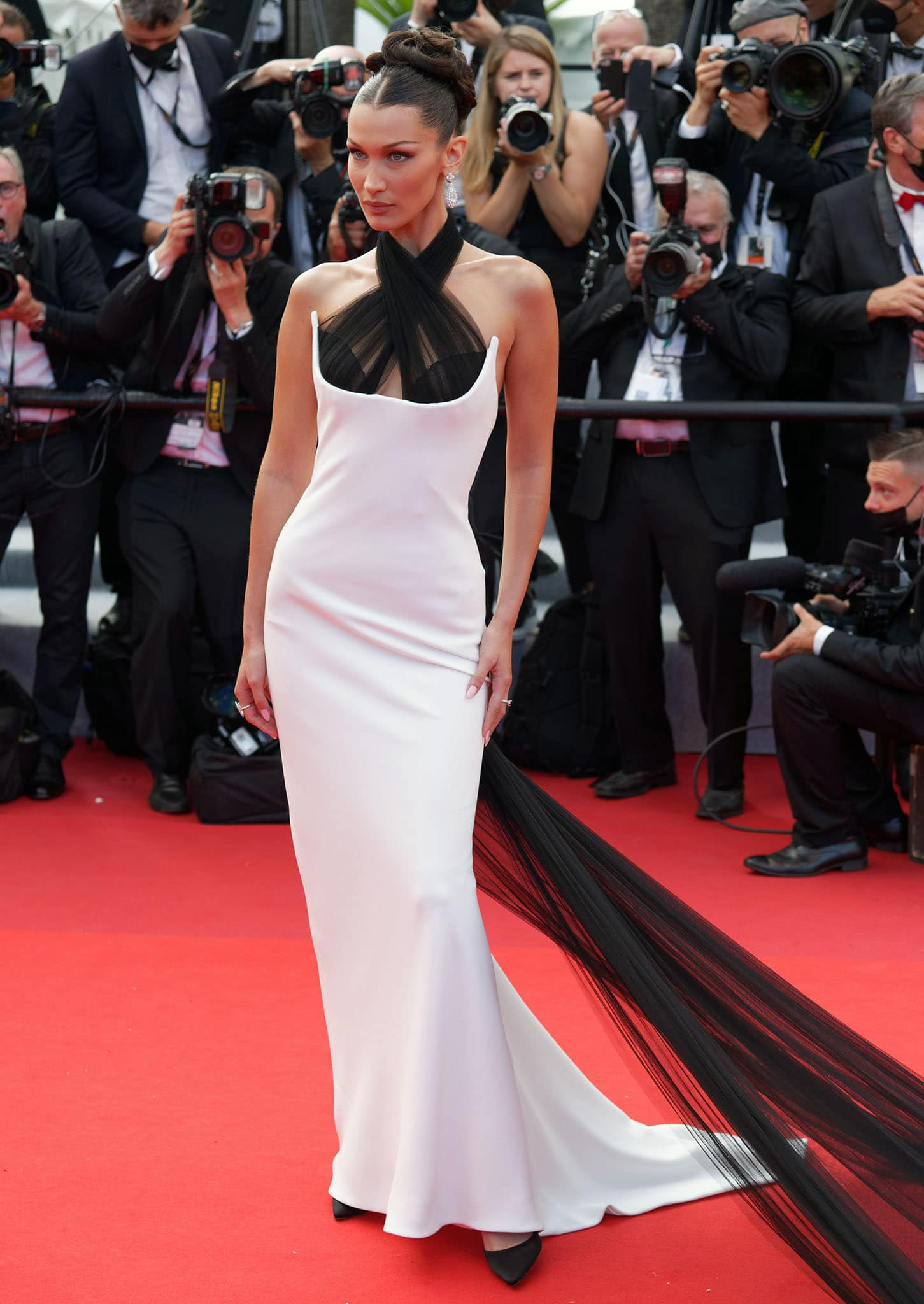 Bella Hadid stuns in her dramatic Jean-Paul Gaultier white gown with sheer black halter neck and train