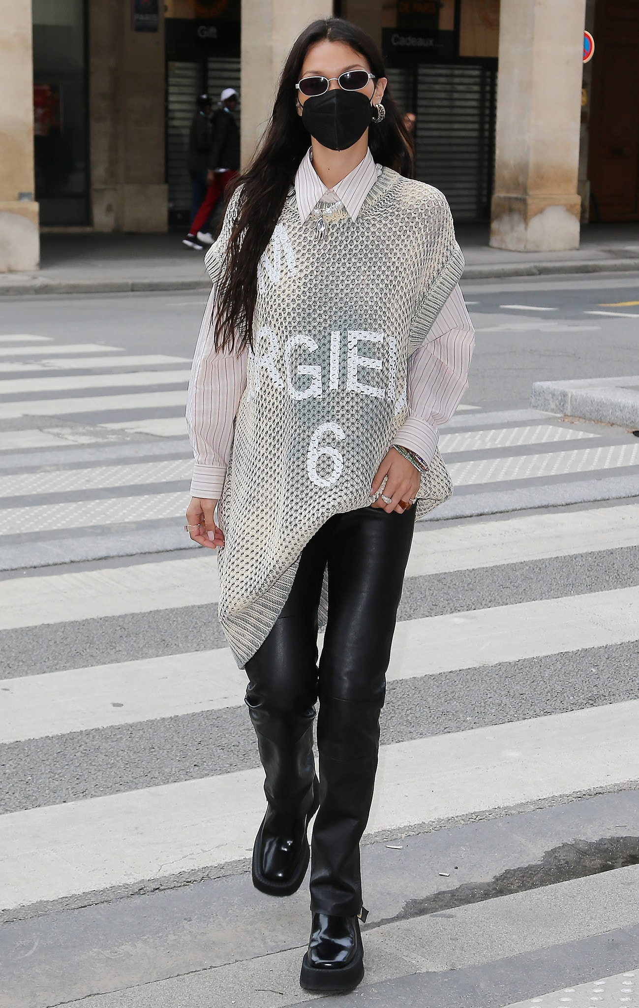 Bella Hadid on her way to the Loulou restaurant in MM6 Maison Margiela knit vest and leather trousers on June 26, 2021