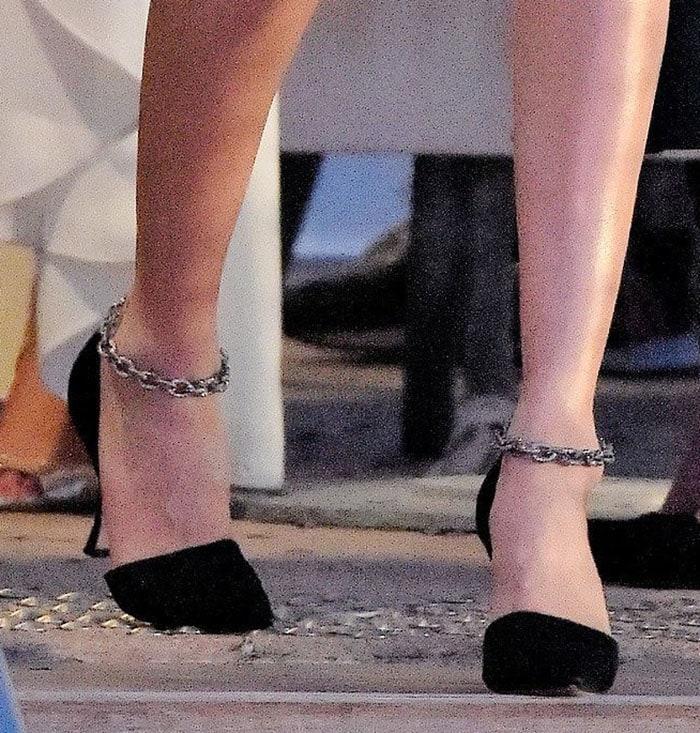 Bella Hadid teams her leg-baring mini dress with Manolo Blahnik Anclara satin pumps