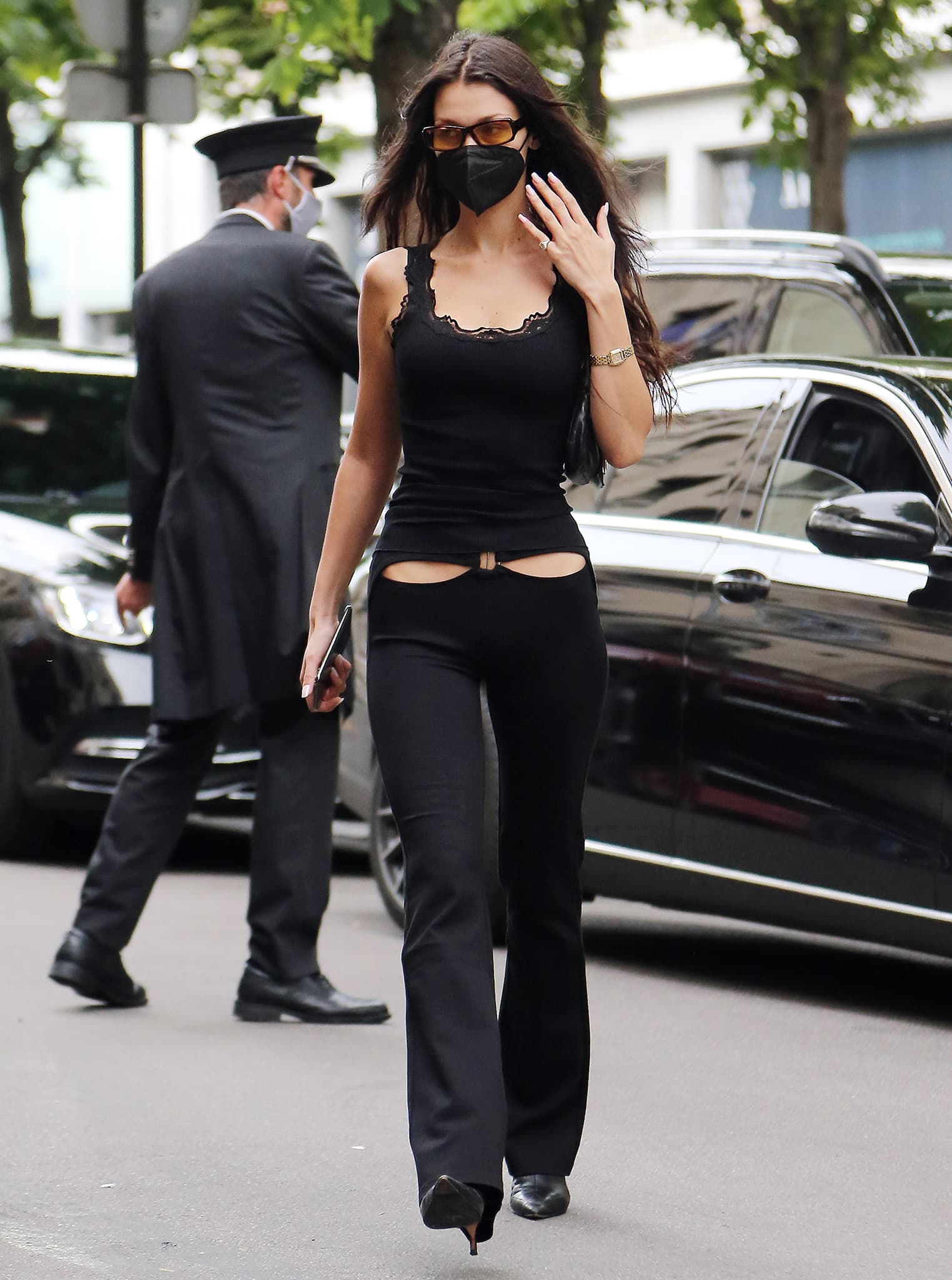 Bella Hadid pairs a Rosemunde lacy top with I.Am.Gia racy hip cutout pants