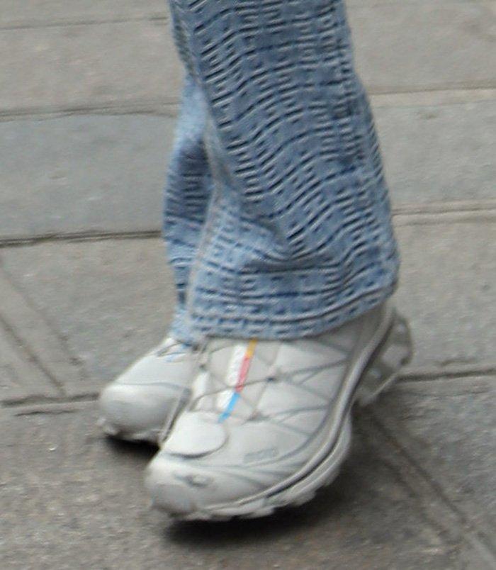 Bella Hadid dressed down her look with Salomon white sneakers