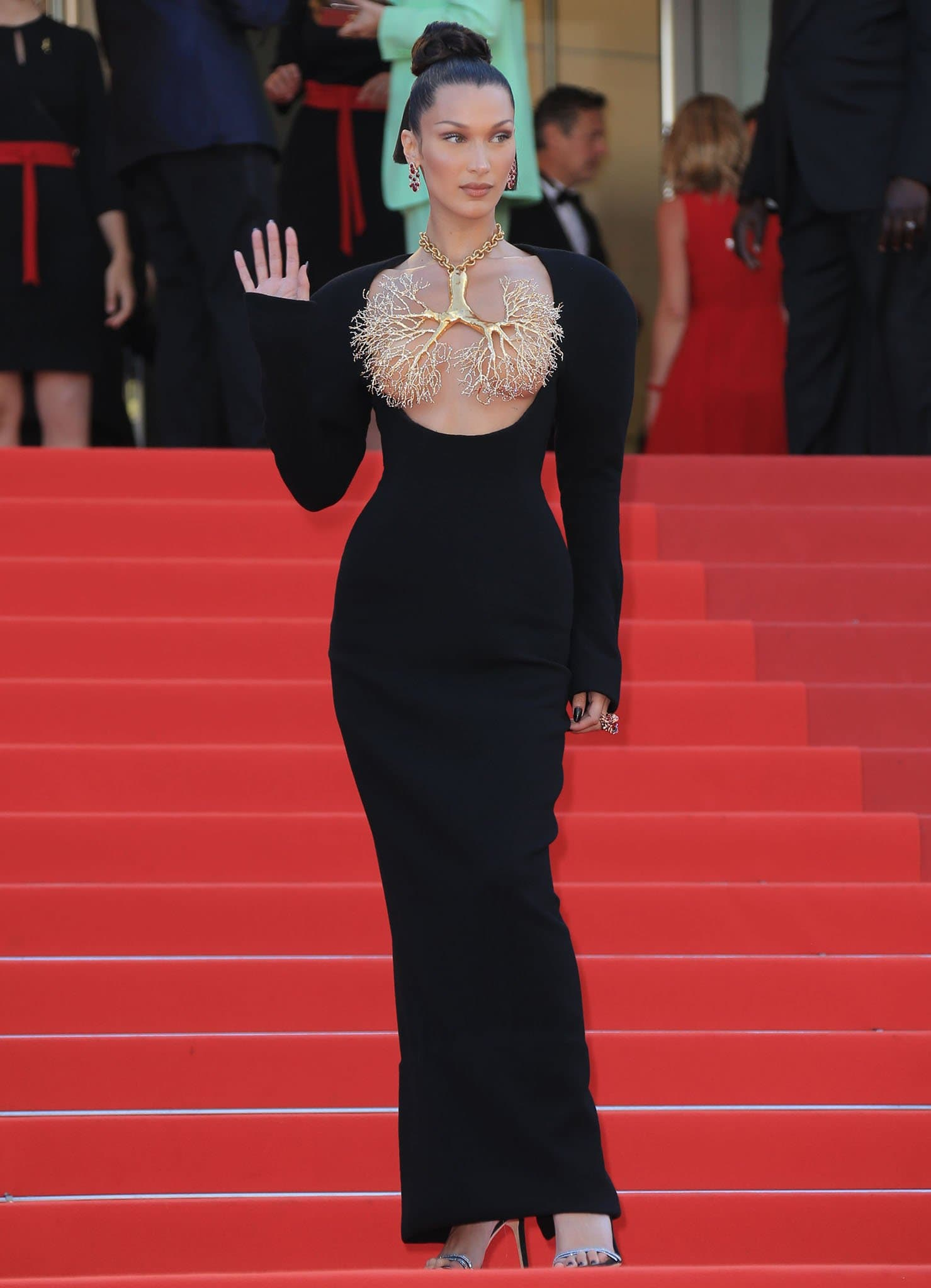 Bella Hadid turns heads in an open neckline black gown from Schiaparelli at the Tre Piani Cannes Film Festival screening on July 11, 2021