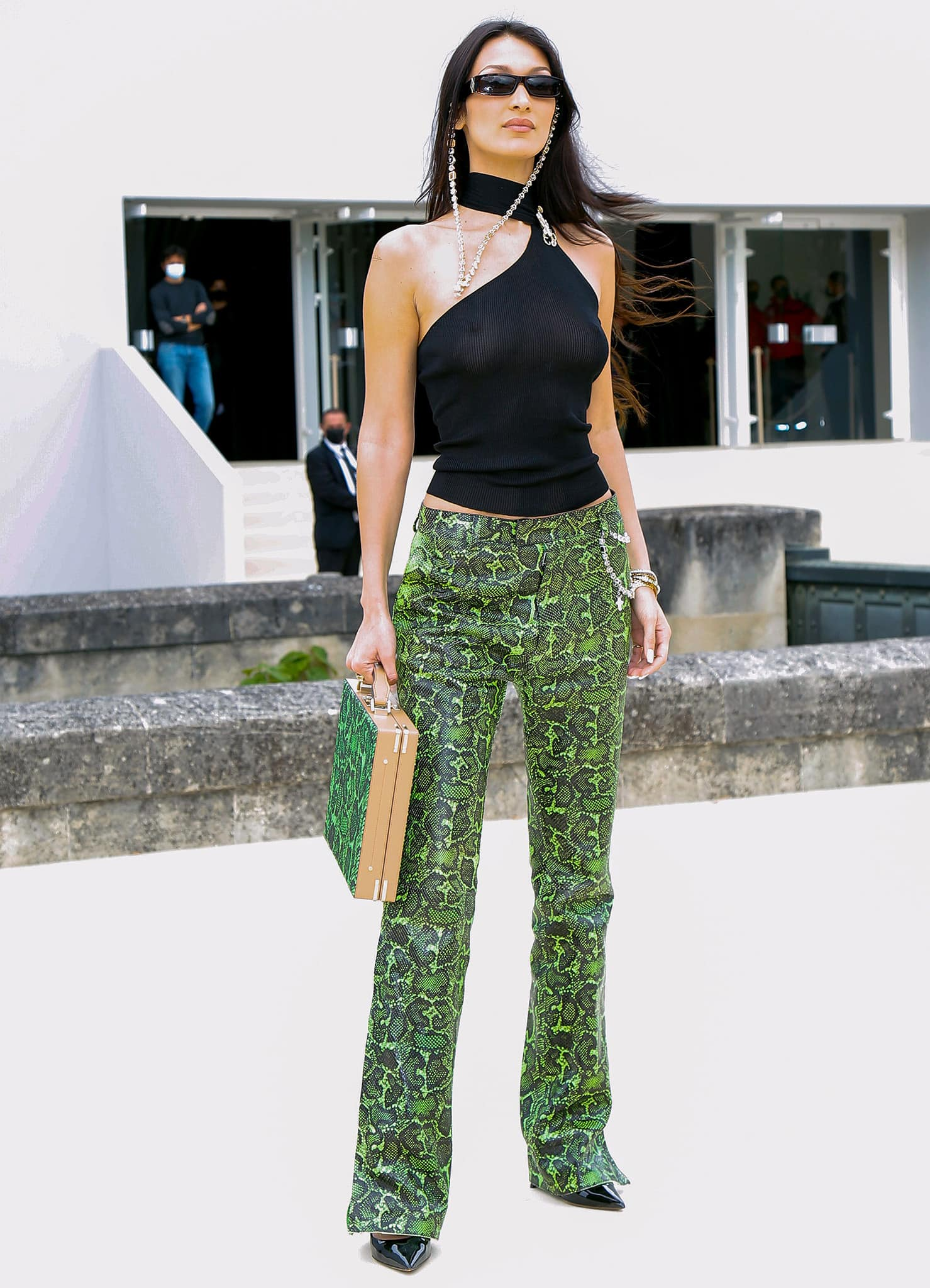 Bella Hadid is braless underneath her Gucci x Tom Ford sheer top paired with Dior green snakeskin trousers