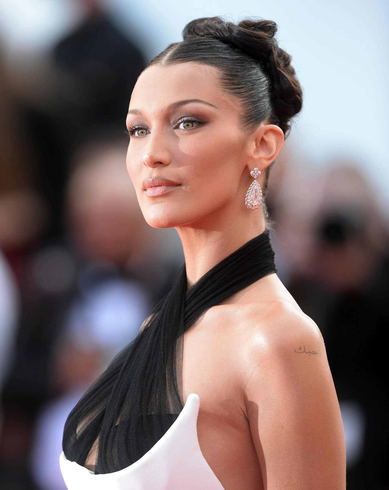 Bella Hadid showcases her Chopard pear-shaped diamond earrings as she wears her tresses in a chic and sleek updo