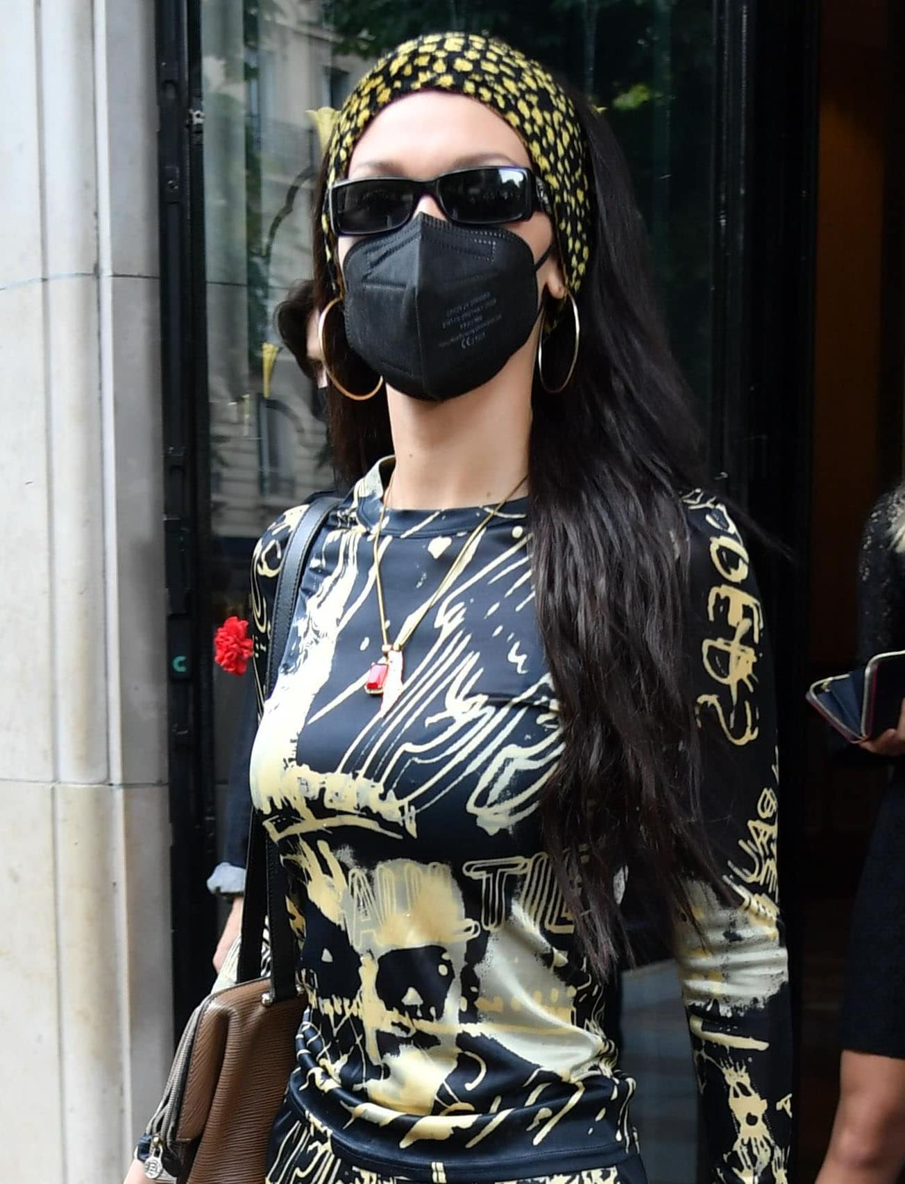 Bella Hadid coordinates her outfit with her dotted bandana headband