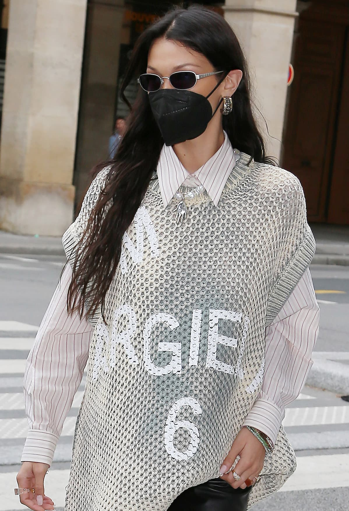 Bella Hadid wears her long tresses down and styles her edgy look with skinny sunglasses and chunky earrings