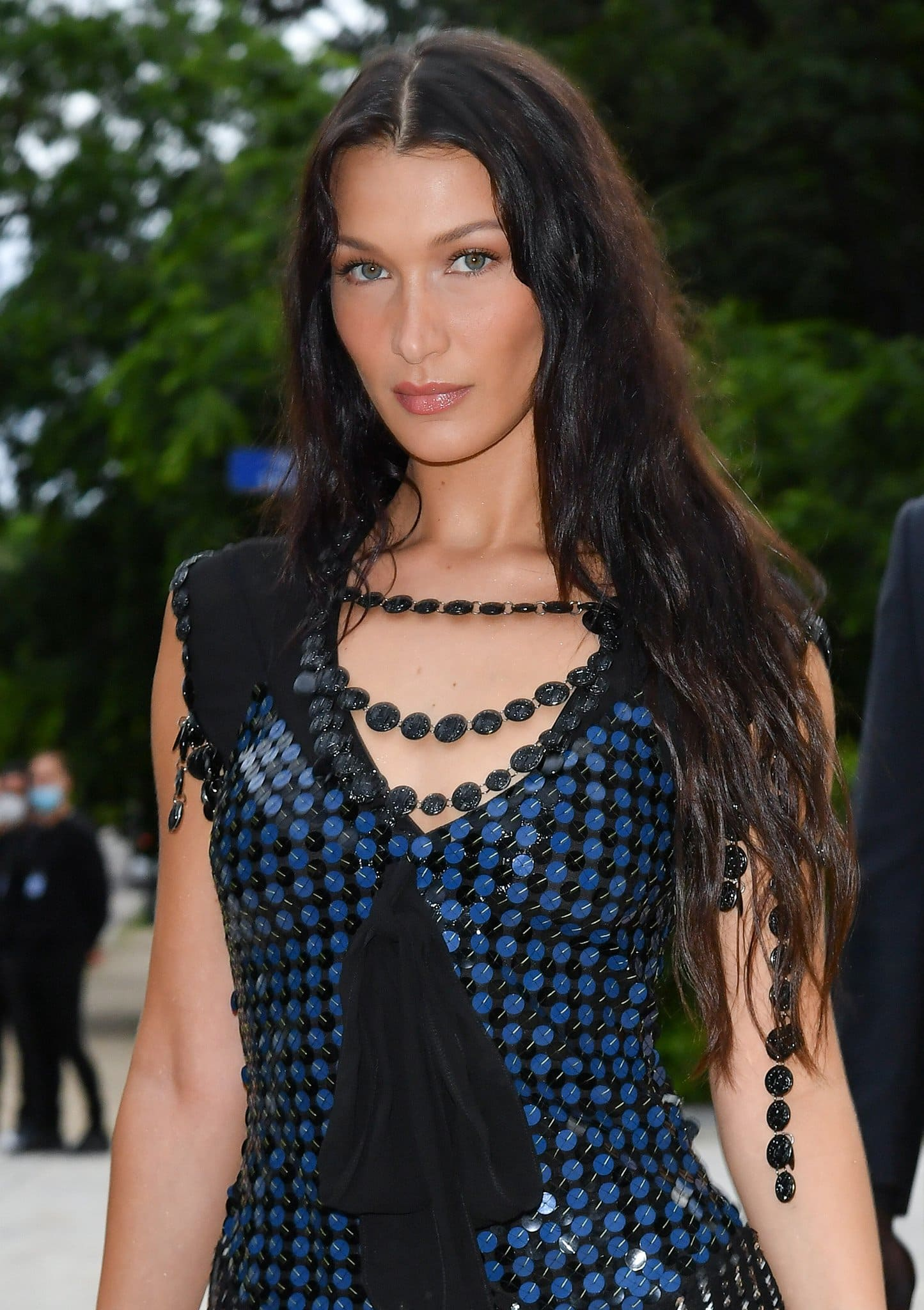 Bella Hadid wears her long hair down in tousled waves and highlights her natural beauty with neutral makeup