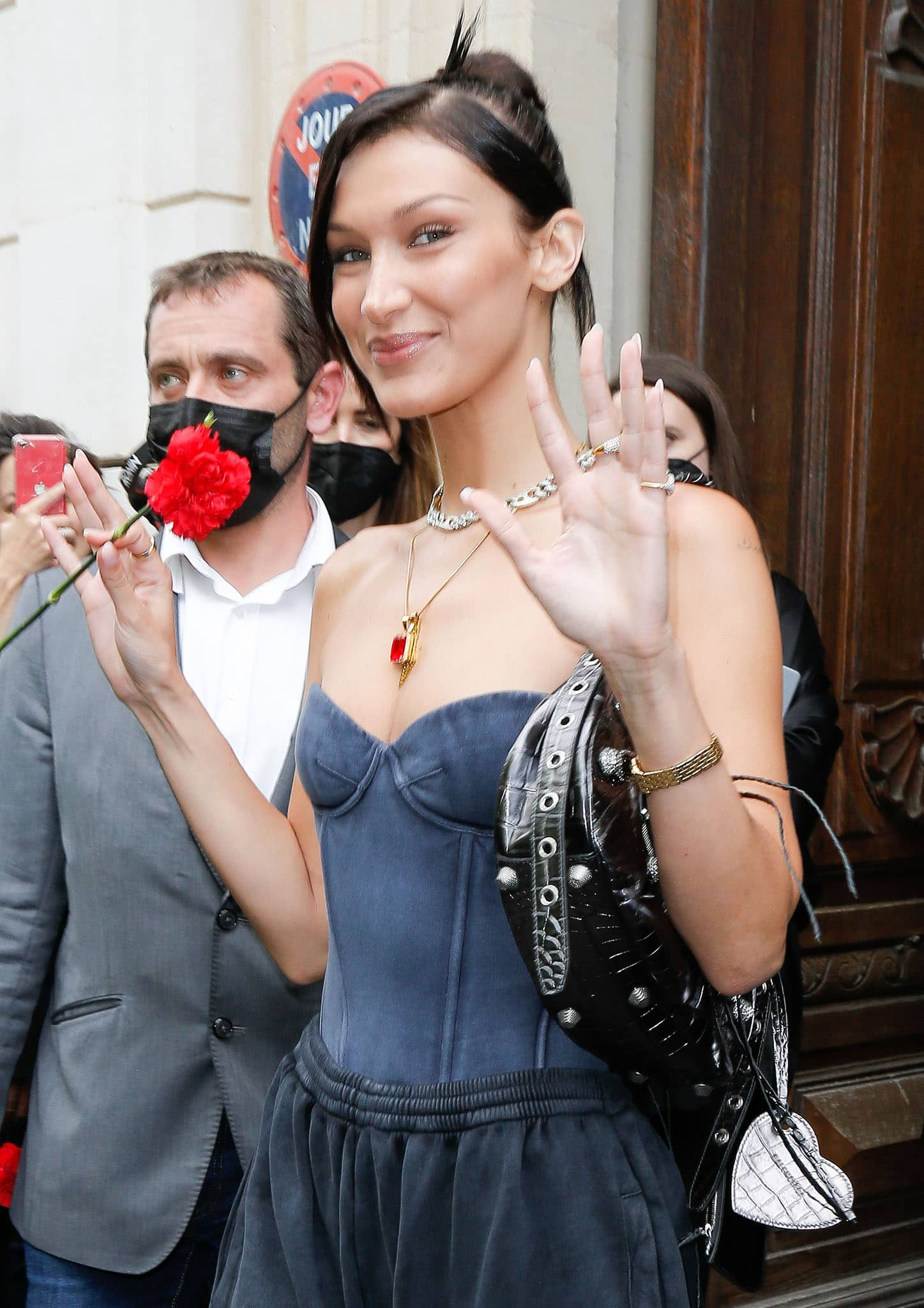 Bella Hadid wears minimal makeup with a chic updo