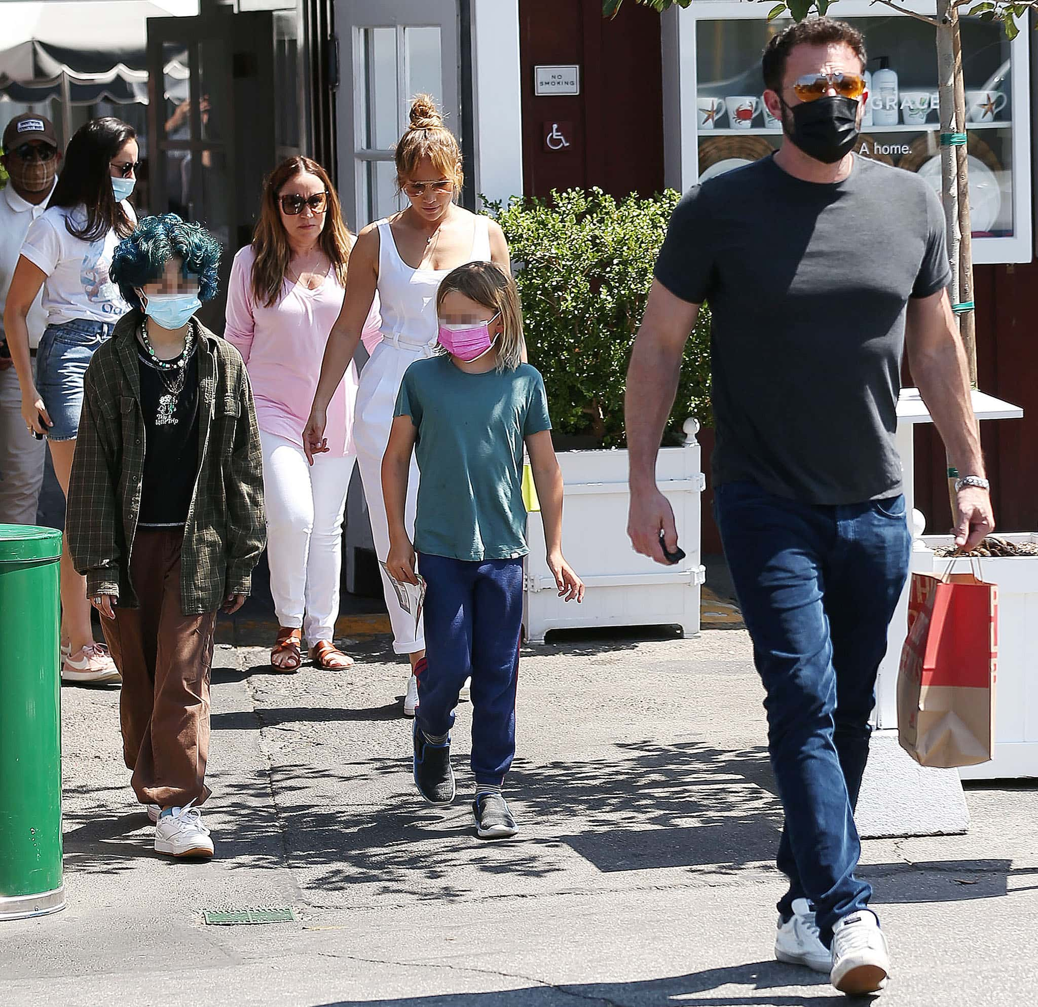 Ben Affleck and Jennifer Lopez take their kids, Emme and Sam, to lunch at Brentwood Country Mart in Santa Monica on July 9, 2021