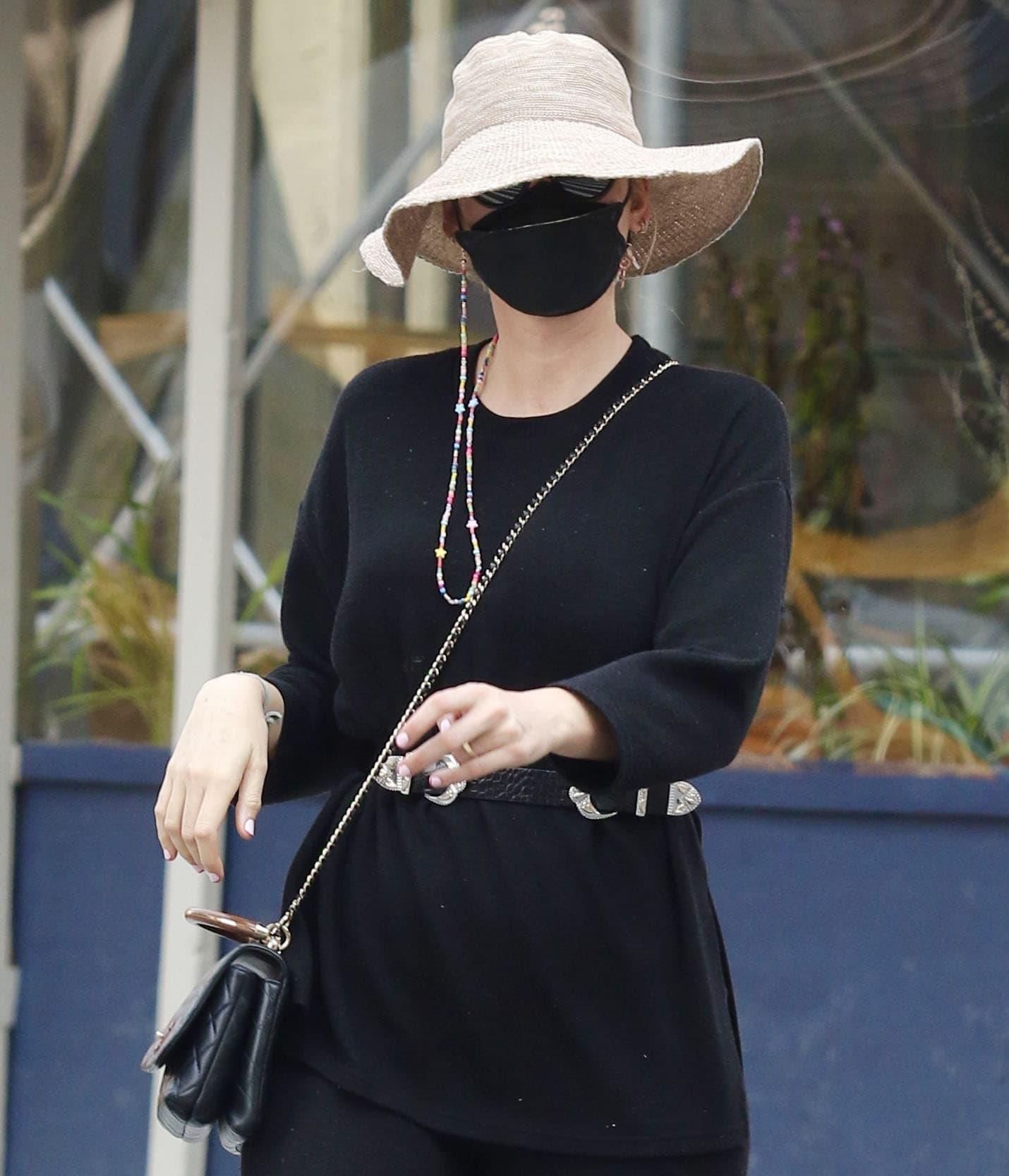 Blake Lively covers her face with David Beckham sunglasses, a black face mask, and a floppy hat