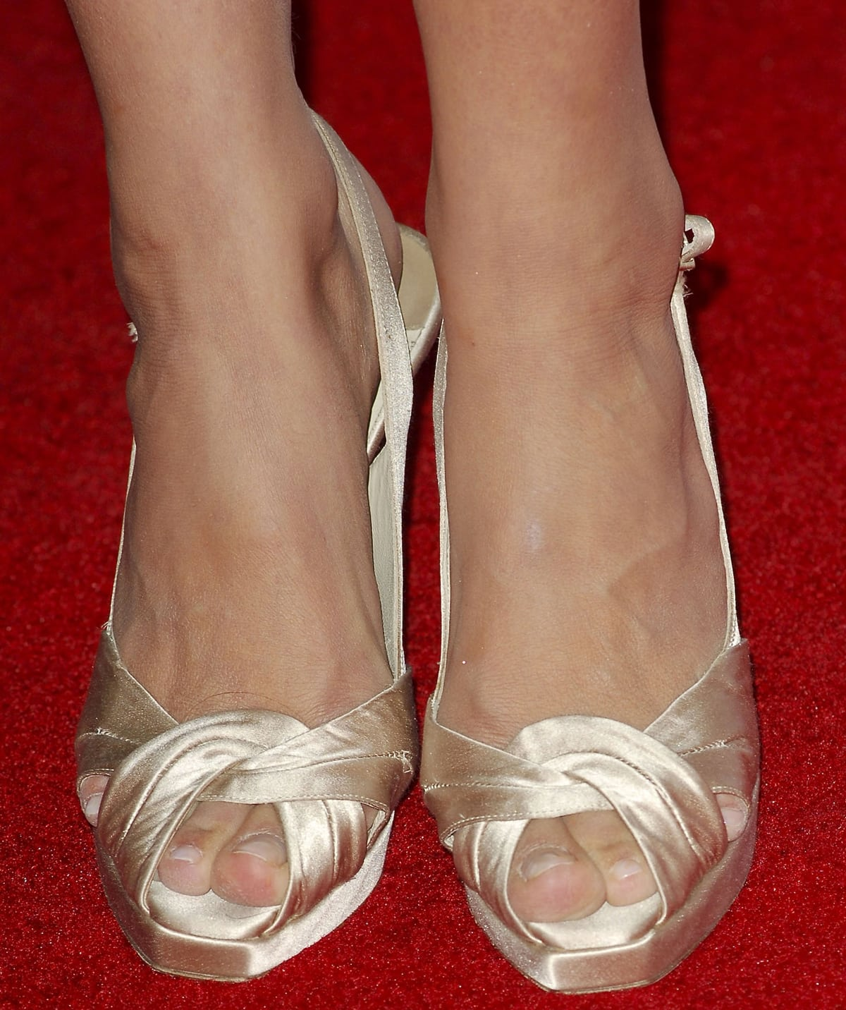 Camilla Belle shows off her size 8 (US) feet in high heels