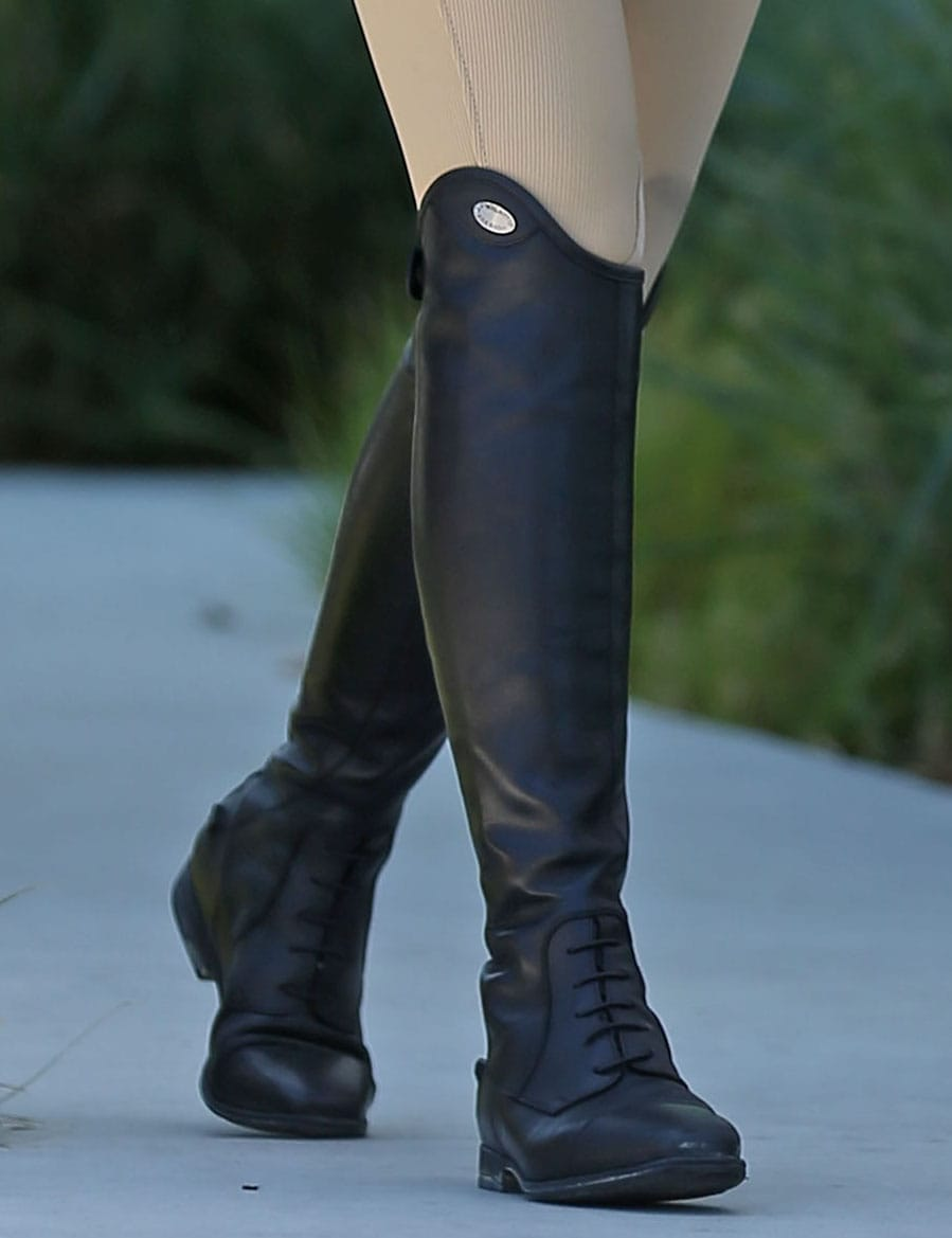 Chrissy Teigen completes an equestrian look with Parlanti Dallas Pro riding boots