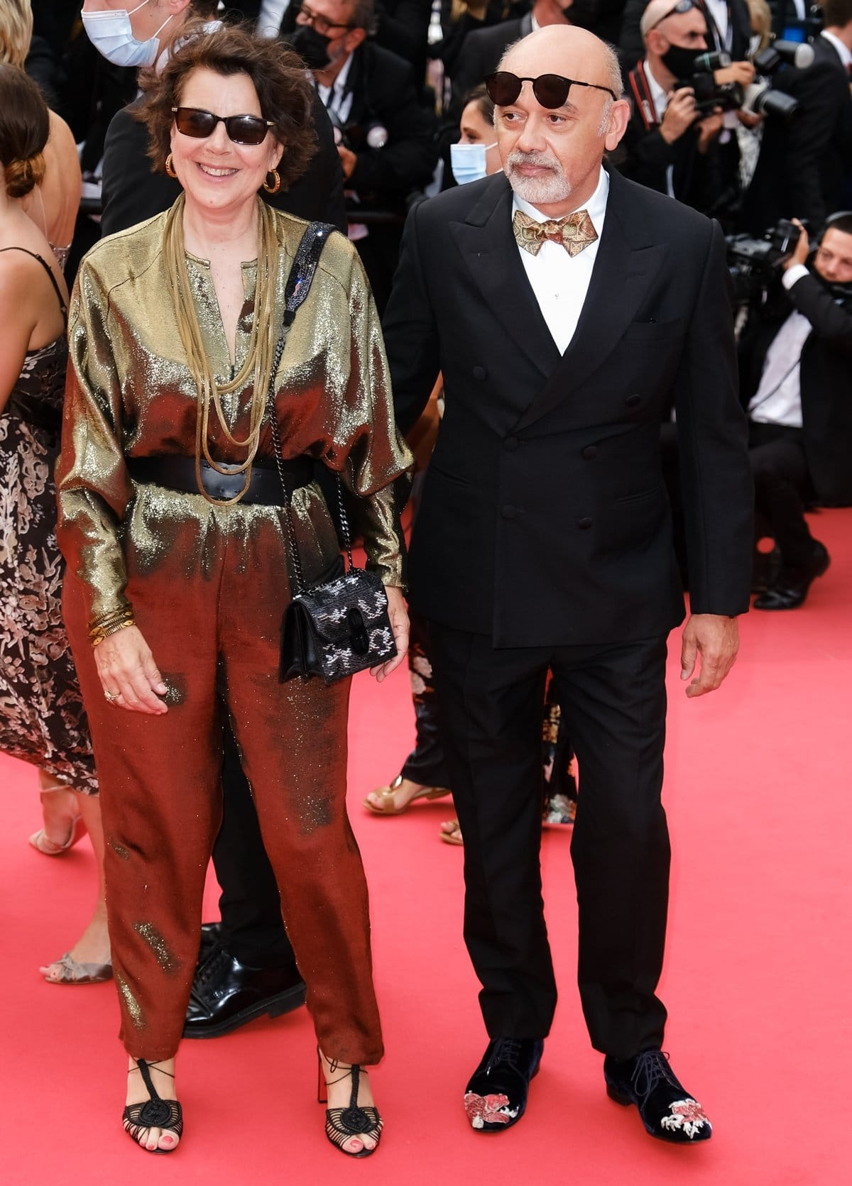 Christian Louboutin (R) and a guest attend the