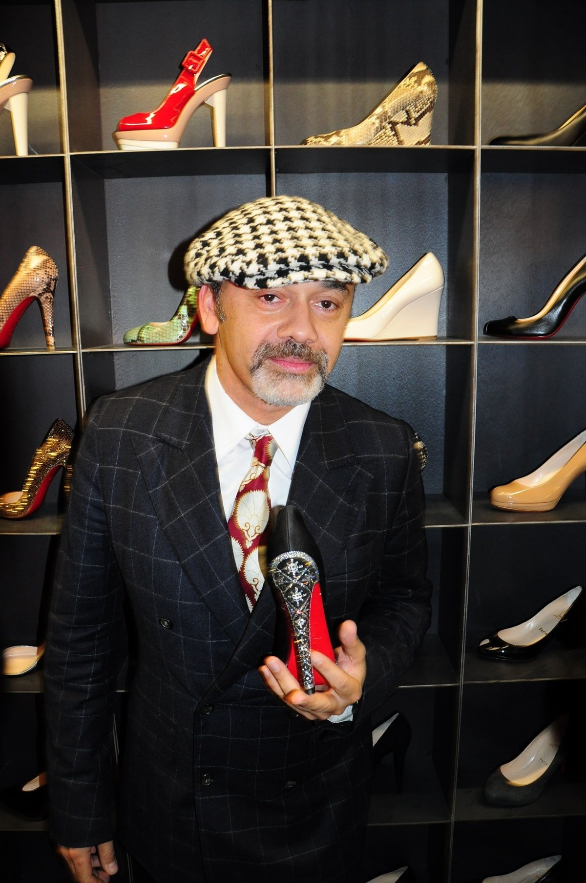 Christian Louboutin promoting his red sole shoes in Berlin