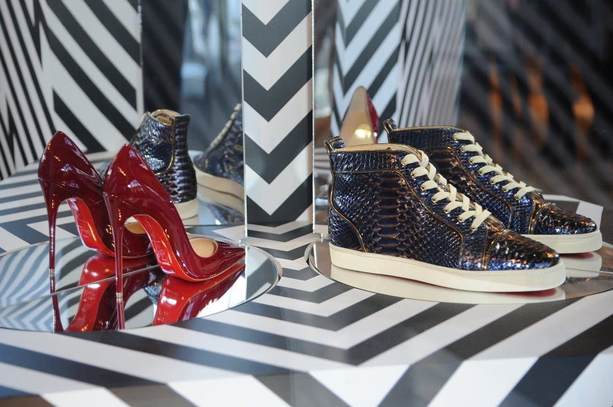 Christian Louboutin high heel pumps and sneakers displayed in his boutique located at Selfridges Exchange Square Store Manchester