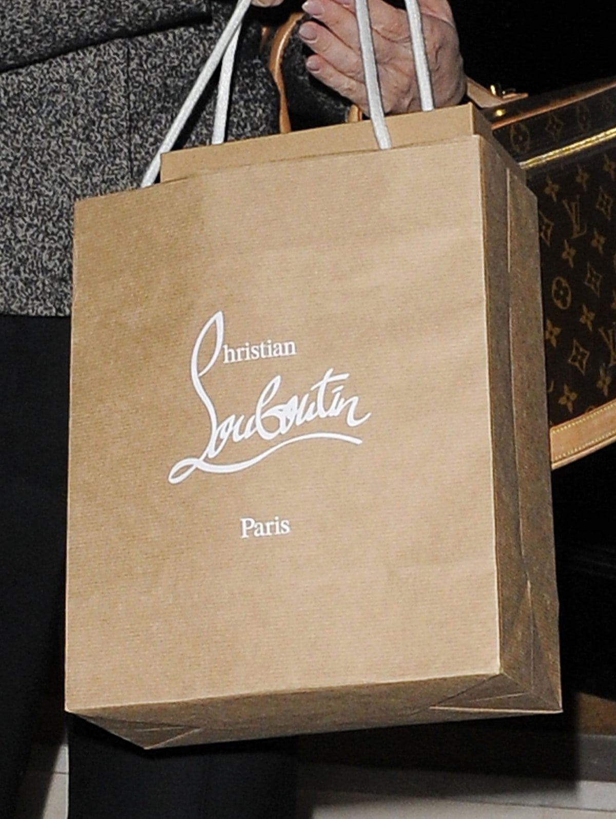 Kelly Brook carries an authentic Christian Louboutin shopping bag